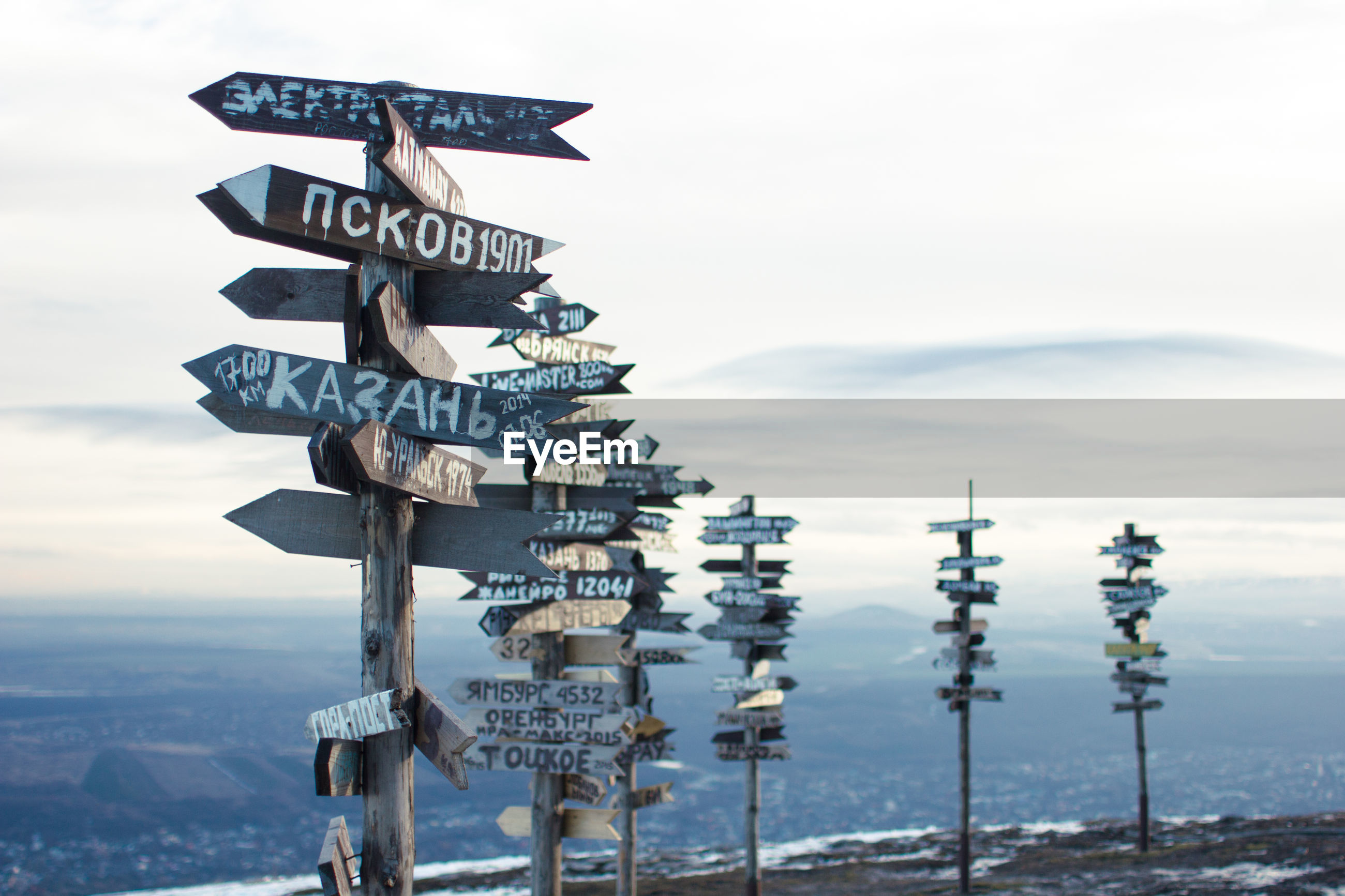 Information signs on mountain against sky
