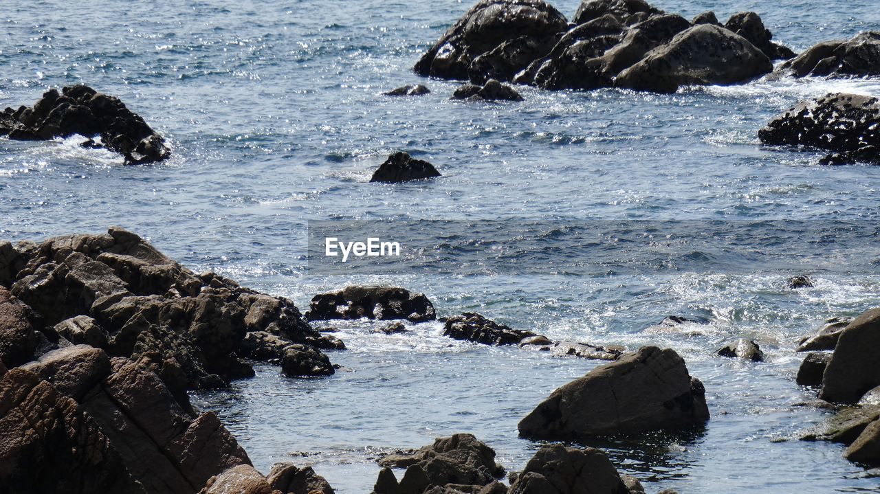 water, rock, sea, rock - object, solid, beauty in nature, motion, day, wave, nature, land, beach, no people, scenics - nature, rock formation, outdoors, waterfront, sport, power in nature, flowing water, marine, breaking