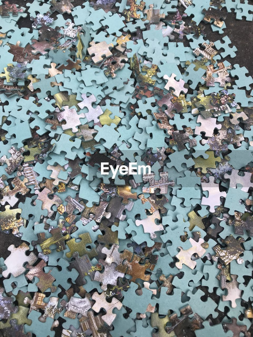 jigsaw piece, jigsaw puzzle, puzzle, large group of objects, solution, indoors, high angle view, no people, abundance, shape, connection, full frame, pattern, design, studio shot, backgrounds, creativity, still life, multi colored, challenge, chaos, excess