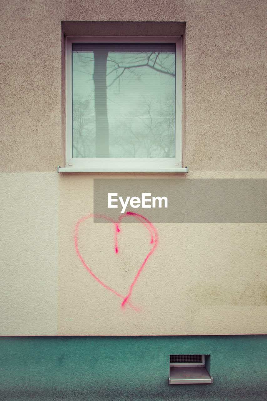 Red heart shape on wall