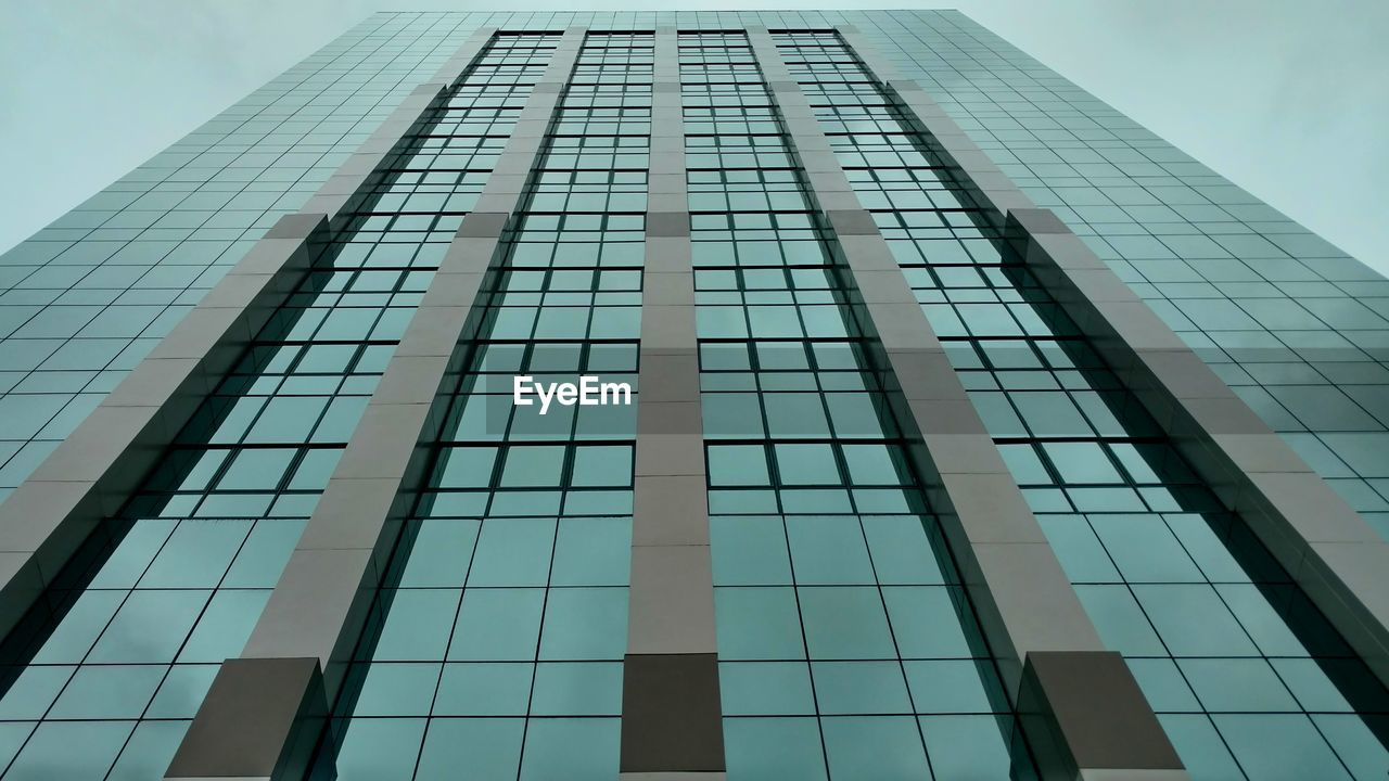 low angle view, architecture, building exterior, building, built structure, office building exterior, city, office, tall - high, modern, no people, glass - material, tower, day, skyscraper, sky, reflection, nature, outdoors, window