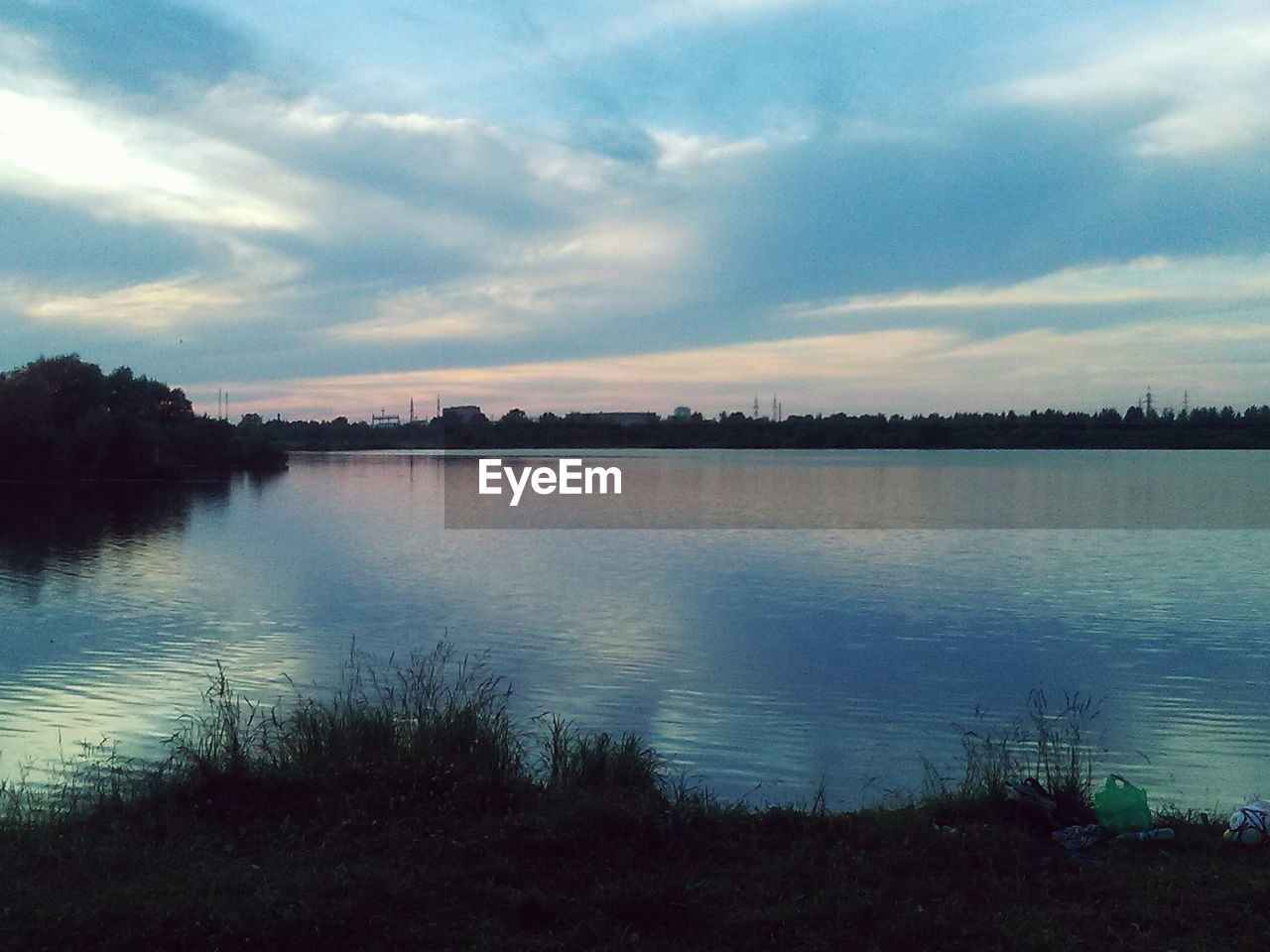 water, sky, cloud - sky, tranquil scene, nature, lake, scenics, tranquility, beauty in nature, no people, reflection, outdoors, tree, travel destinations, landscape, sunset, day, grass