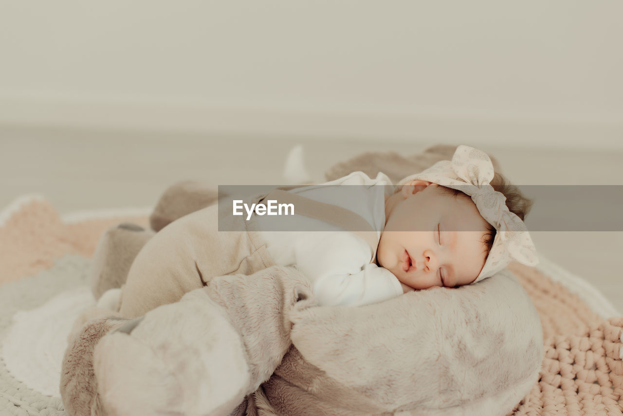 baby, young, childhood, child, lying down, babyhood, one person, sleeping, real people, innocence, eyes closed, cute, relaxation, newborn, indoors, bed, beginnings, blanket