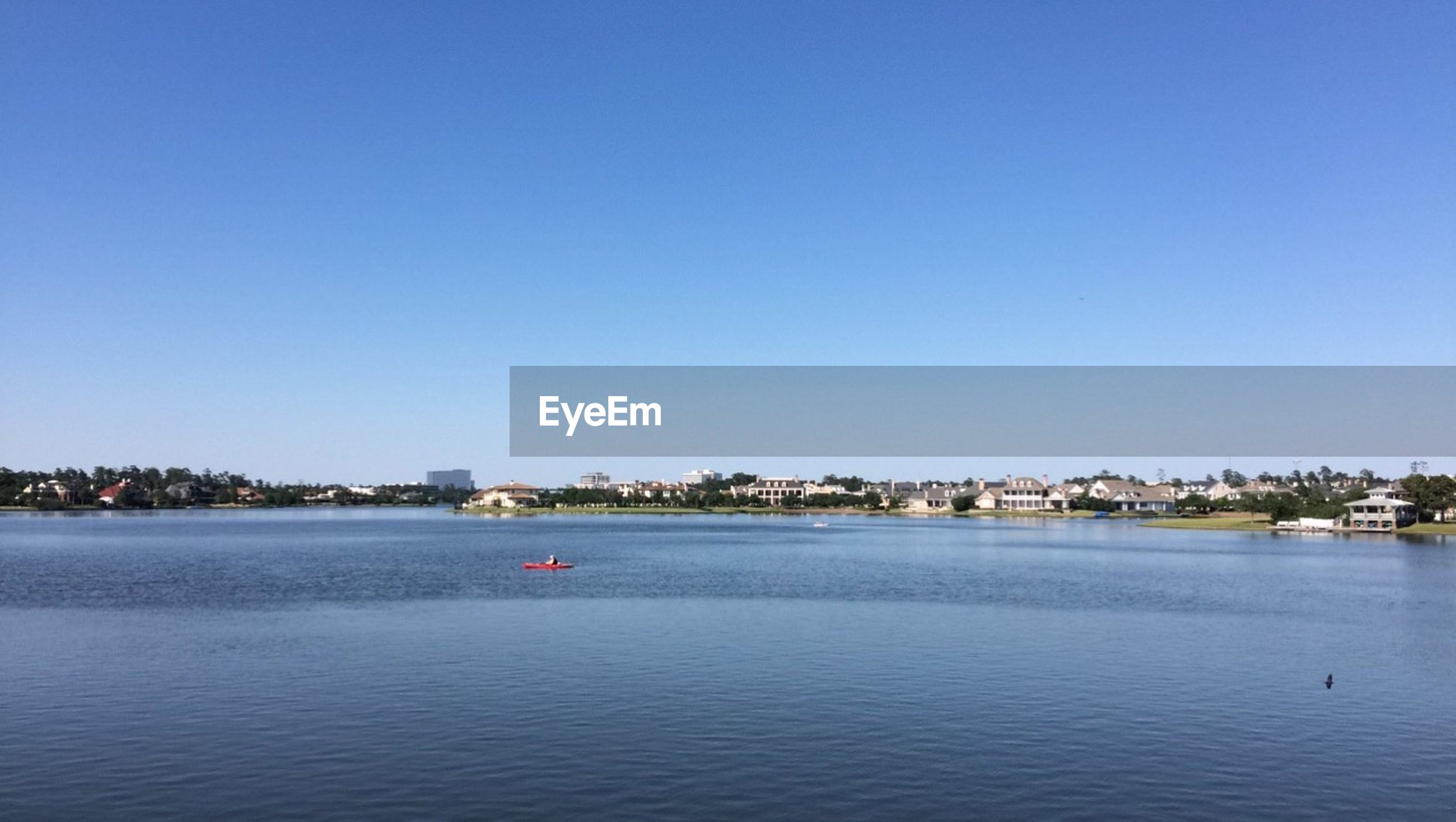 architecture, water, clear sky, building exterior, copy space, no people, blue, built structure, waterfront, day, outdoors, cityscape, nature, lake, view into land, scenics, tranquility, nautical vessel, city, sky, beauty in nature