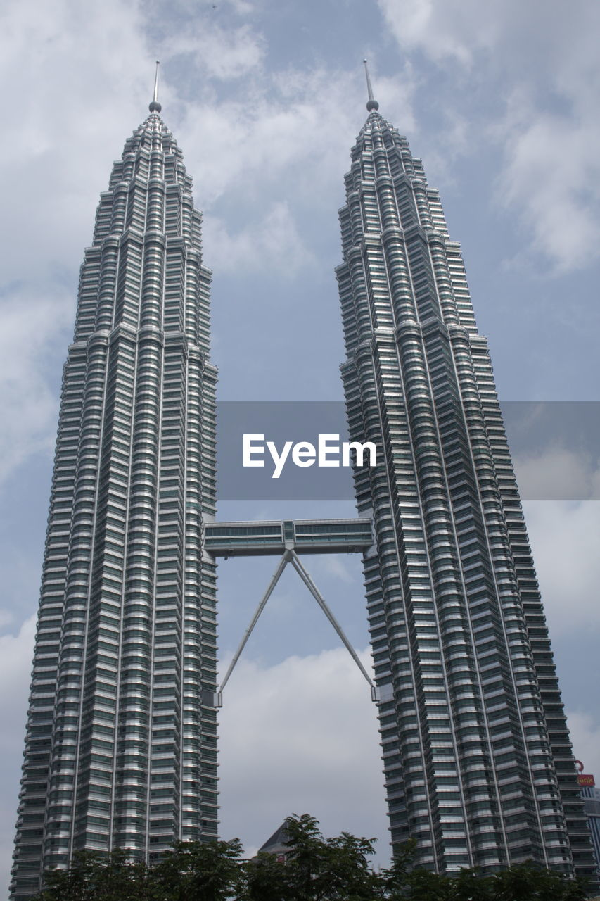 built structure, architecture, sky, tall - high, building exterior, travel destinations, low angle view, city, tower, tourism, skyscraper, cloud - sky, nature, no people, office building exterior, travel, bridge, building, modern, bridge - man made structure, outdoors, spire