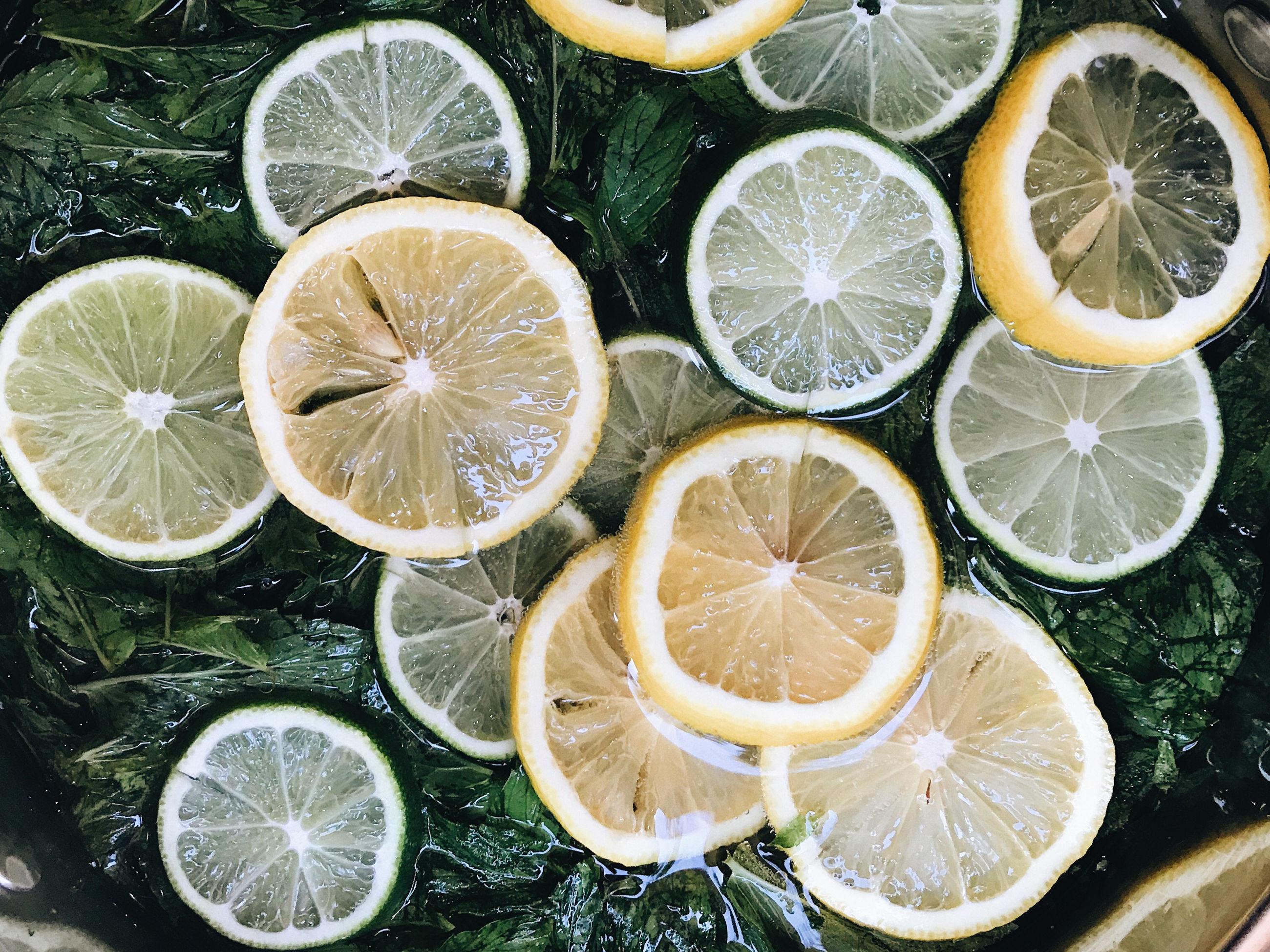 High angle view of lemonade with lemons and mint