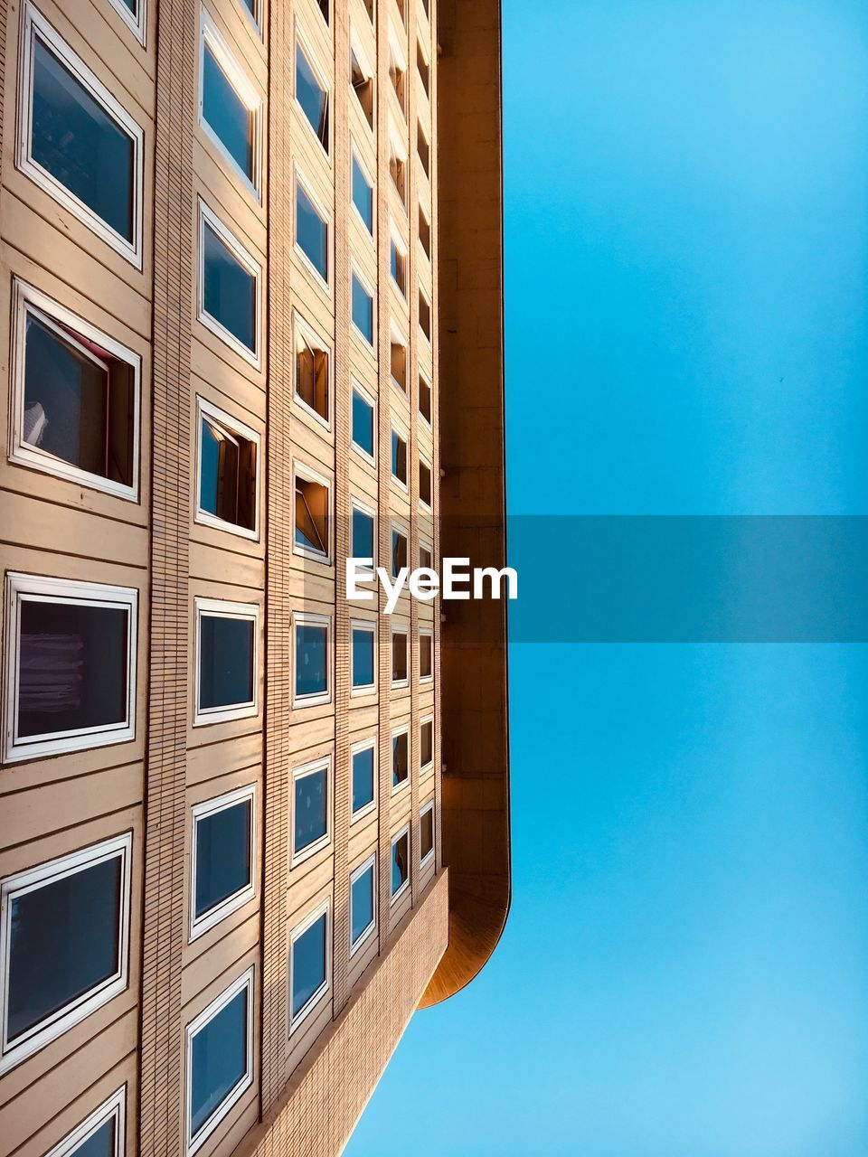architecture, building exterior, built structure, window, blue, day, outdoors, no people, sky, low angle view, clear sky, city