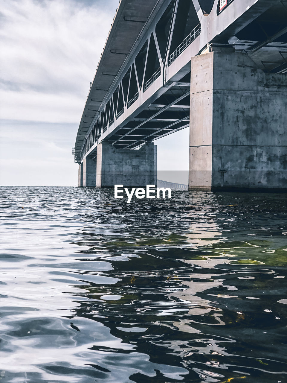 built structure, architecture, water, waterfront, bridge, bridge - man made structure, connection, sky, no people, sea, nature, day, cloud - sky, building exterior, transportation, outdoors, architectural column, rippled, underneath
