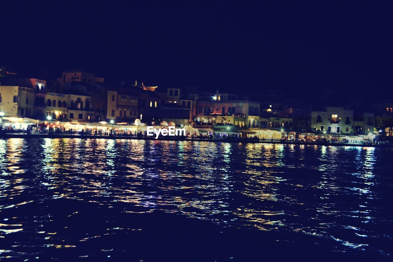 building exterior, architecture, built structure, water, night, waterfront, city, illuminated, outdoors, cityscape, river, residential building, no people, sky, nautical vessel, nature, residential