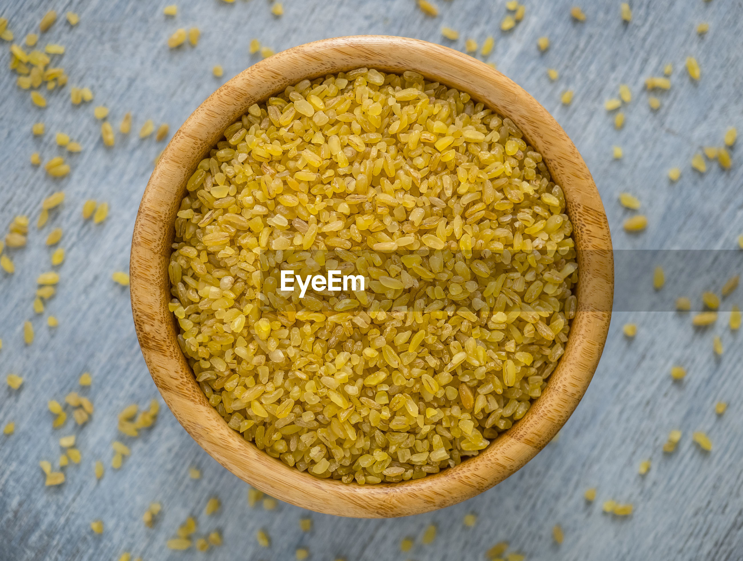 Raw bulgur groats in a plate on the table