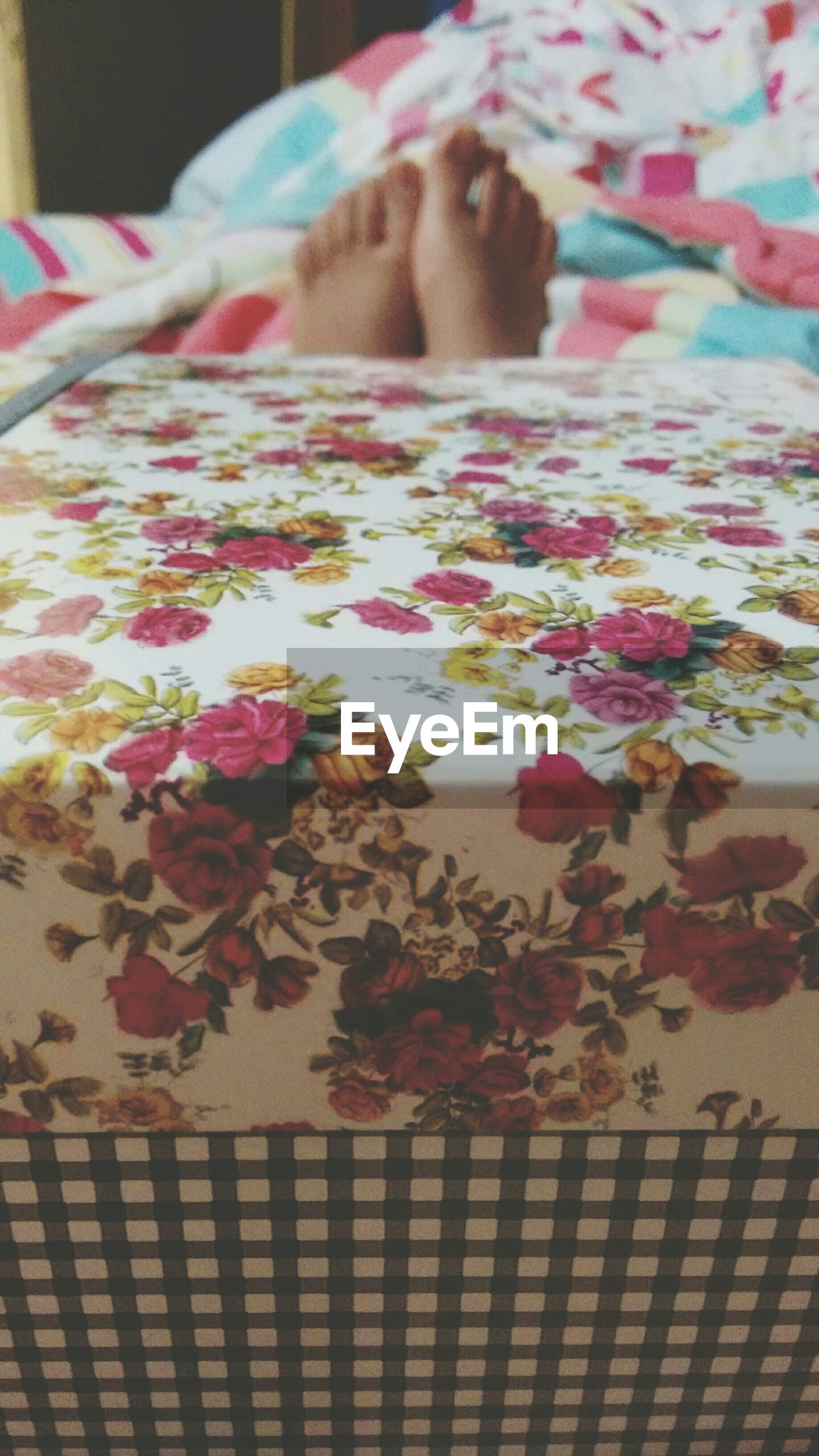 indoors, close-up, creativity, art and craft, pattern, still life, table, floral pattern, art, multi colored, paper, no people, decoration, design, high angle view, home interior, selective focus, fabric, textile, focus on foreground