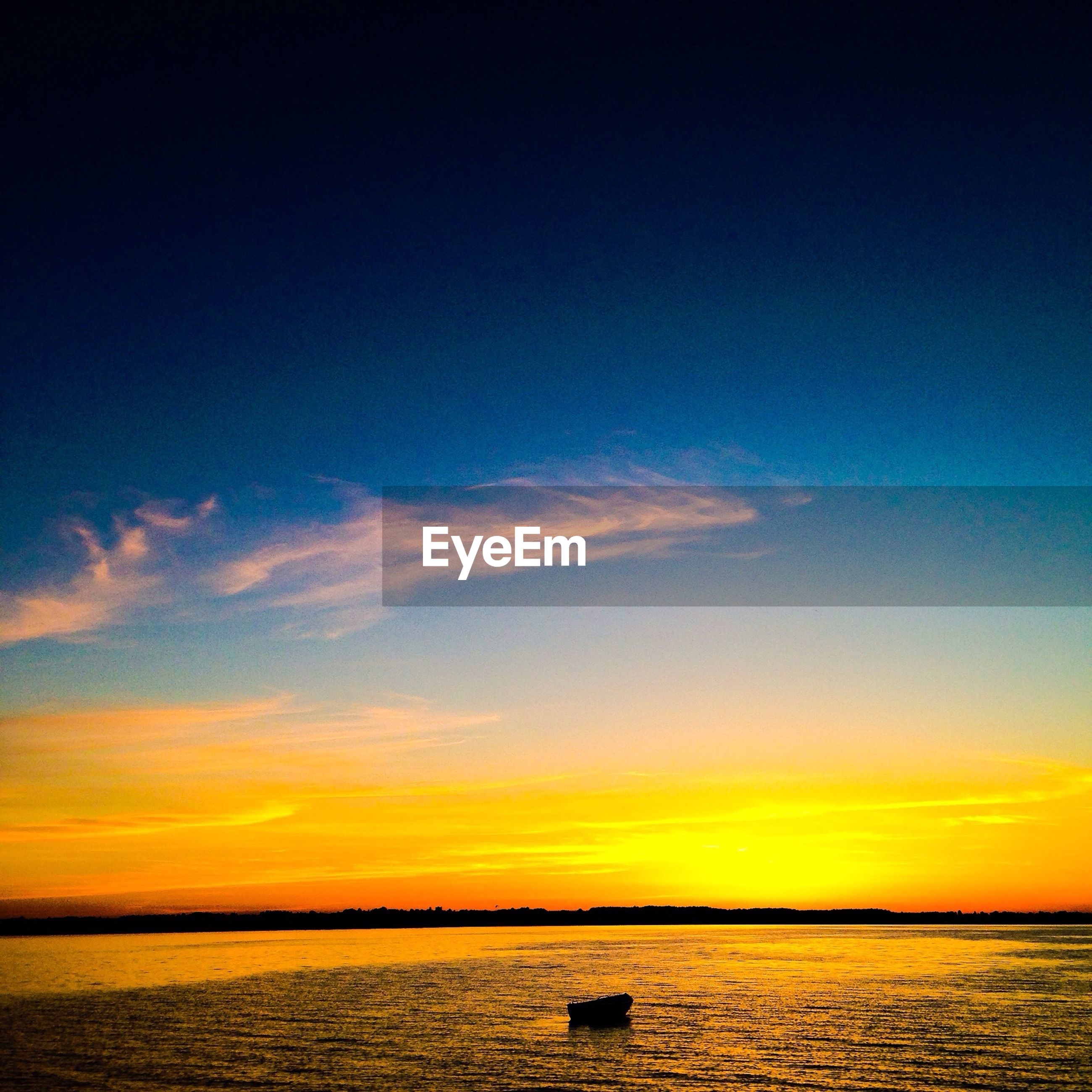 Scenic view of sunset sky over lake