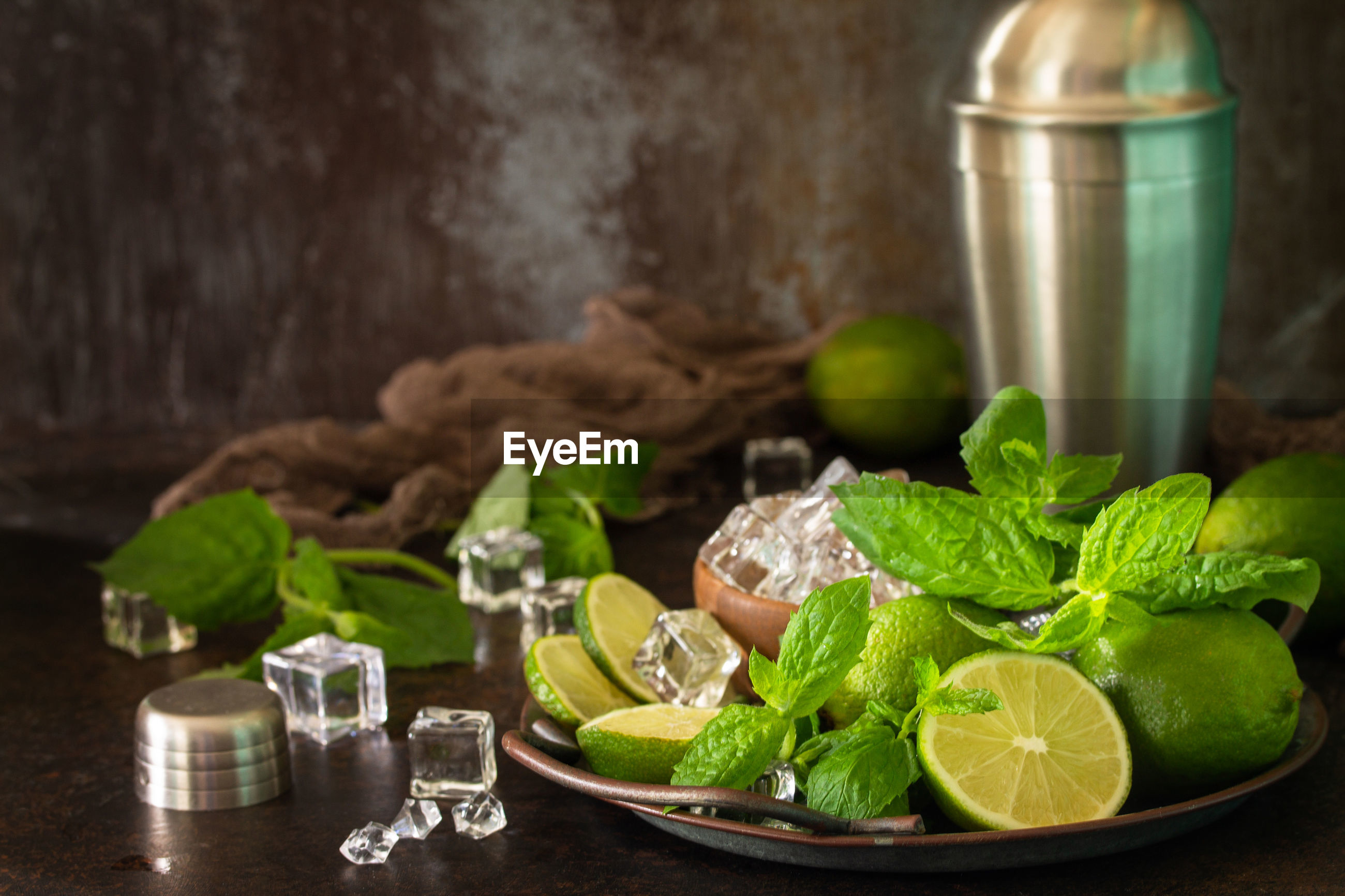 FRESH GREEN FRUITS WITH VEGETABLES AND LEAVES