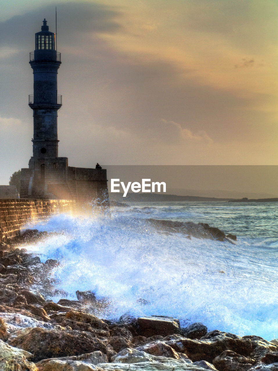 water, sea, sky, built structure, tower, architecture, motion, cloud - sky, building exterior, horizon over water, horizon, beauty in nature, wave, lighthouse, nature, beach, guidance, land, scenics - nature, no people, power in nature, breaking, outdoors, hitting