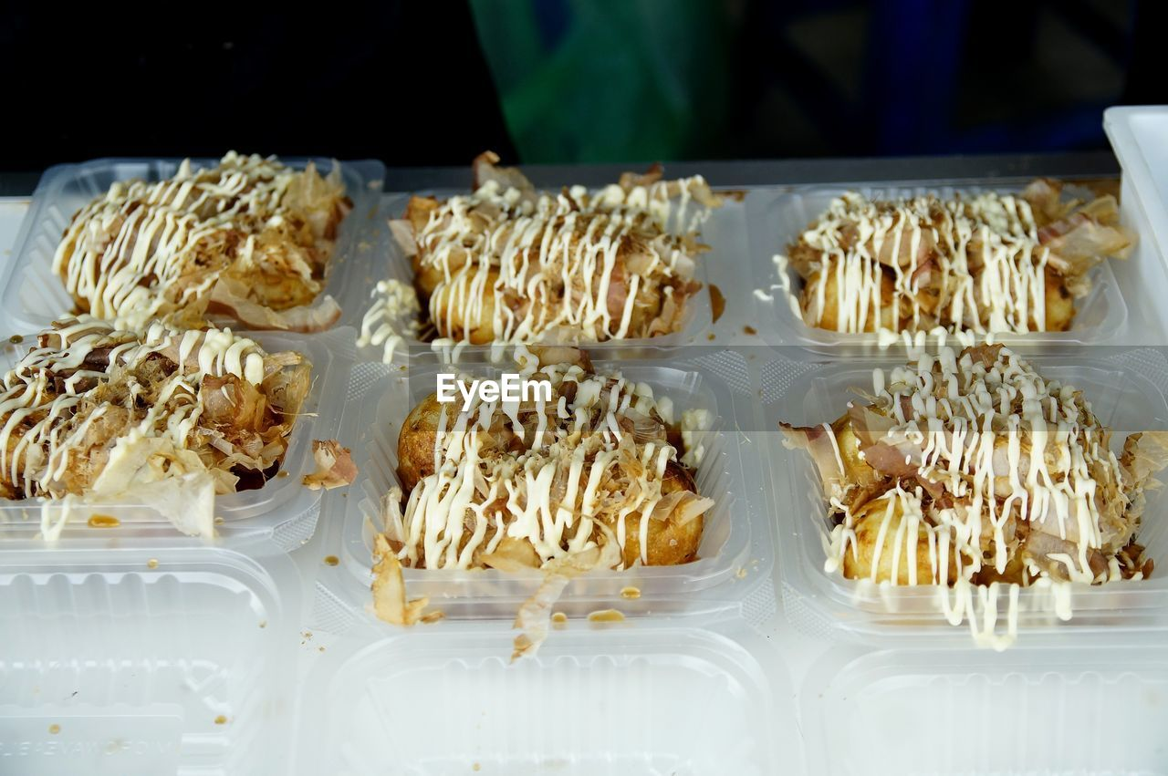 CLOSE-UP OF SWEET FOOD IN TRAY ON TABLE