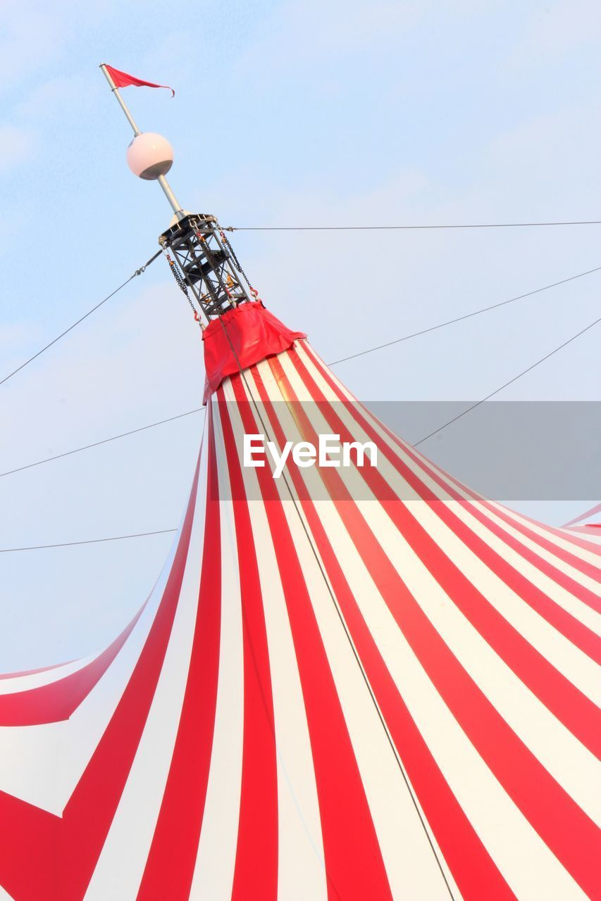 red, striped, low angle view, nature, sky, no people, day, flag, patriotism, cable, celebration, outdoors, textile, built structure, blue, wind, environment, decoration, shape, white color