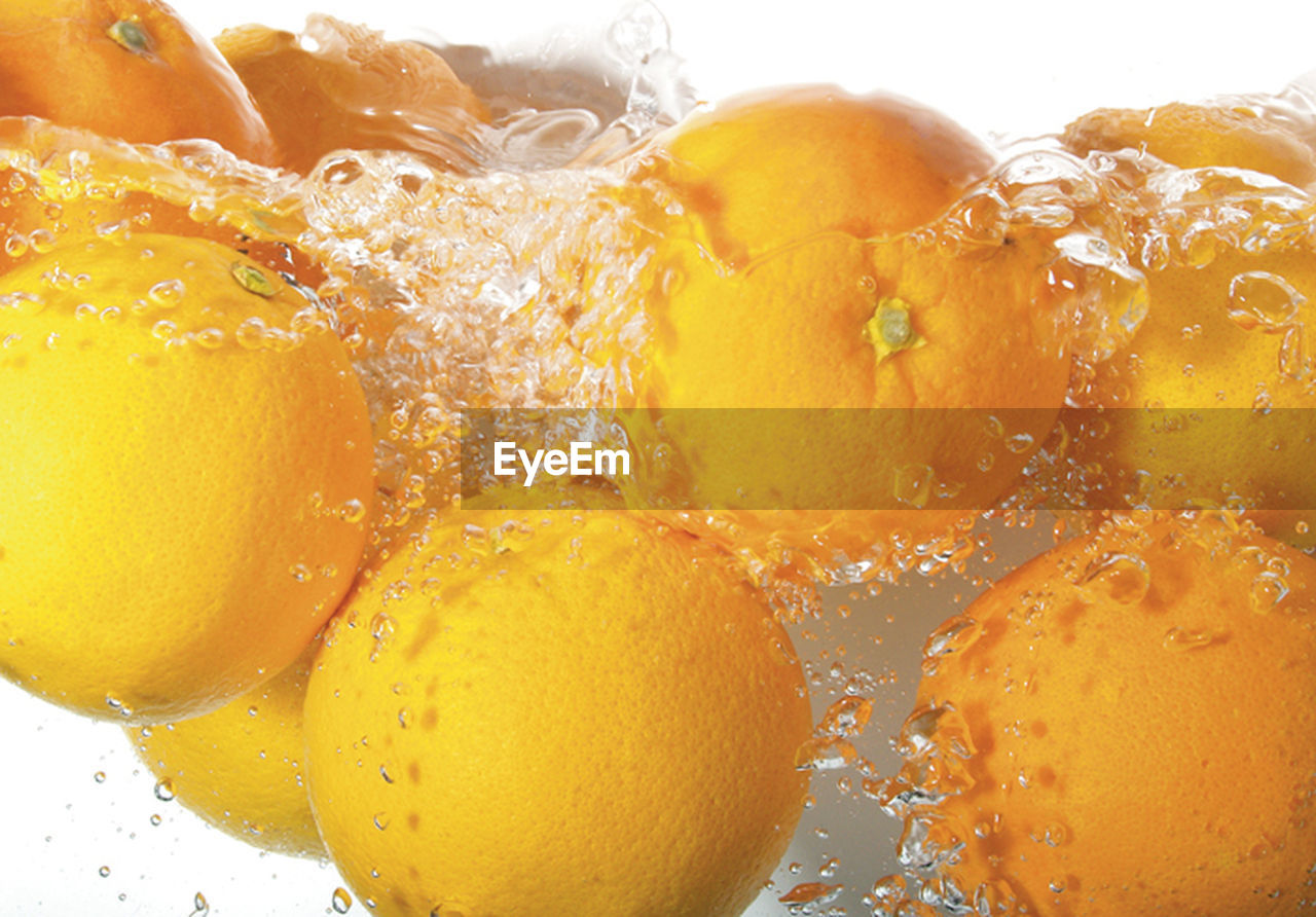 food and drink, drink, refreshment, yellow, freshness, healthy eating, fruit, citrus fruit, orange color, slice, close-up, no people, drinking glass, full frame, lemon soda, backgrounds, cold temperature, food, white background, day