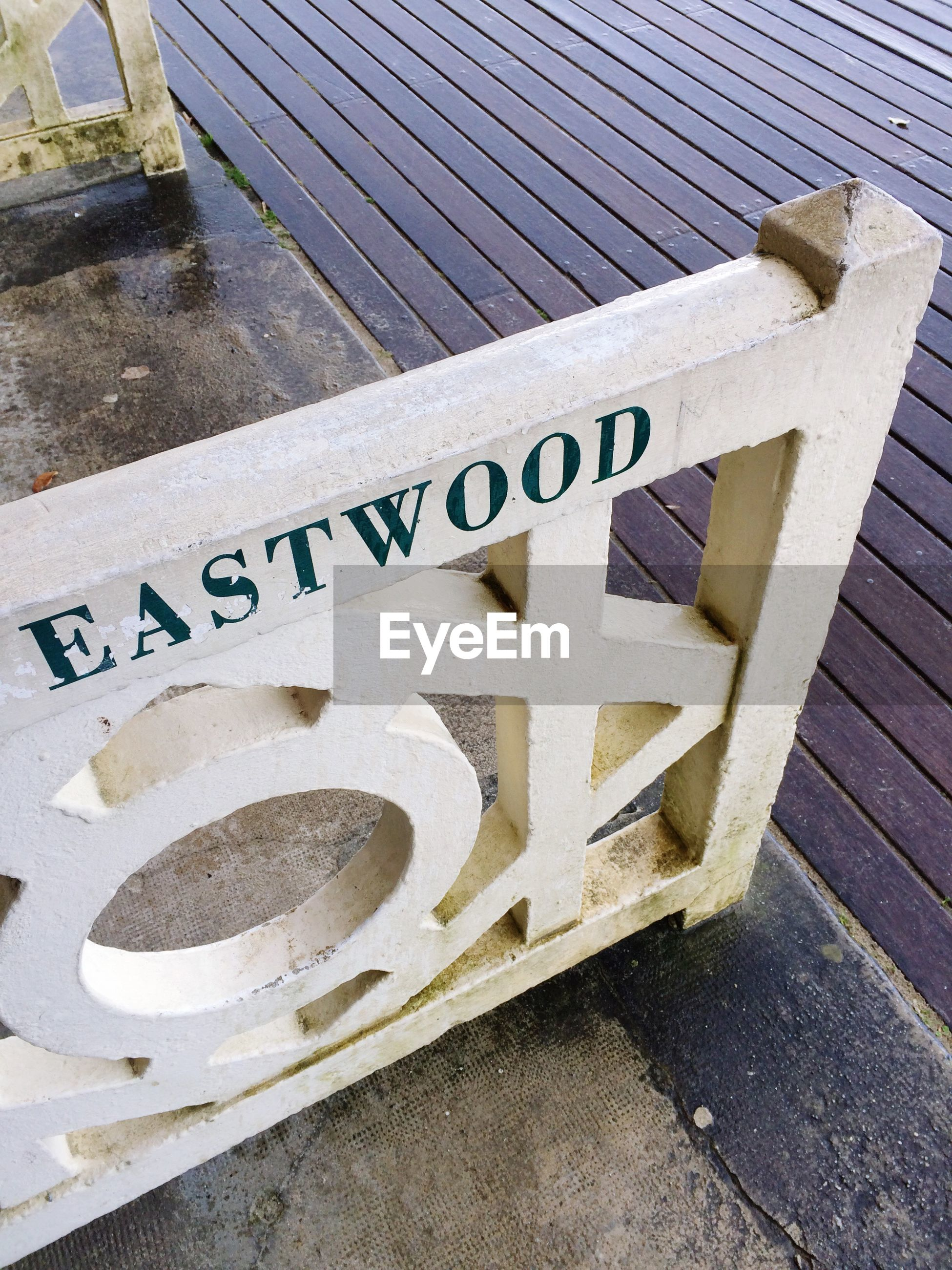 text, western script, communication, capital letter, information sign, high angle view, sign, information, guidance, non-western script, arrow symbol, street, day, message, directional sign, no people, outdoors, sidewalk, close-up, warning sign