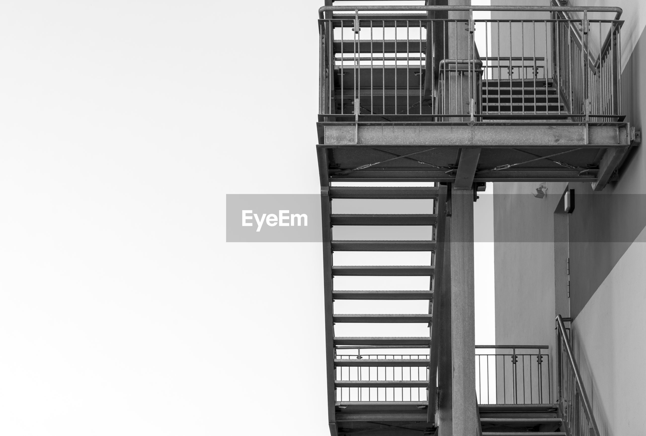 Low angle view of fire escape on building against clear sky