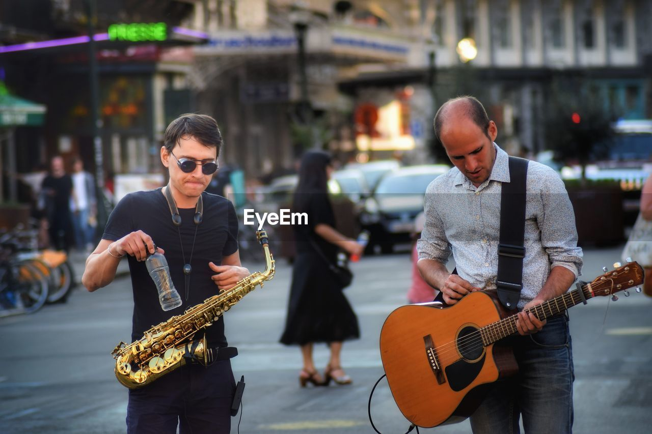 Men Playing Music On City Street