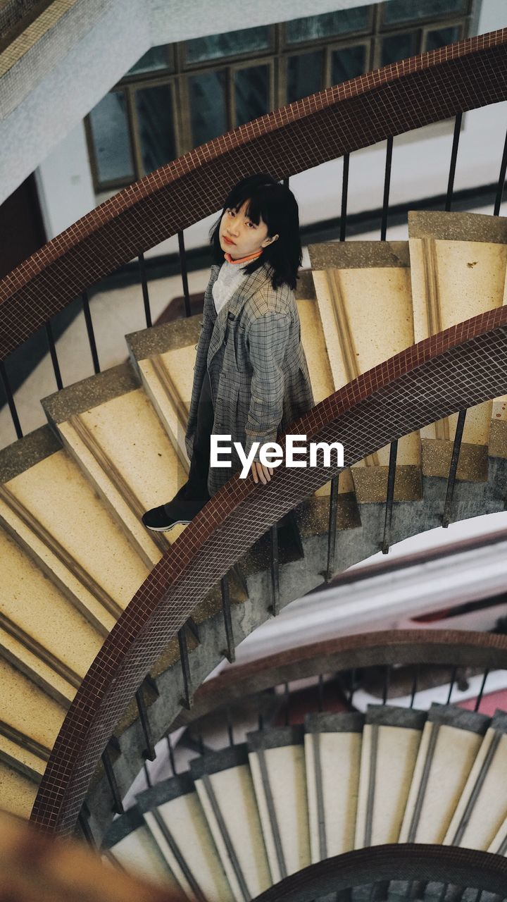 Woman On Spiral Staircase