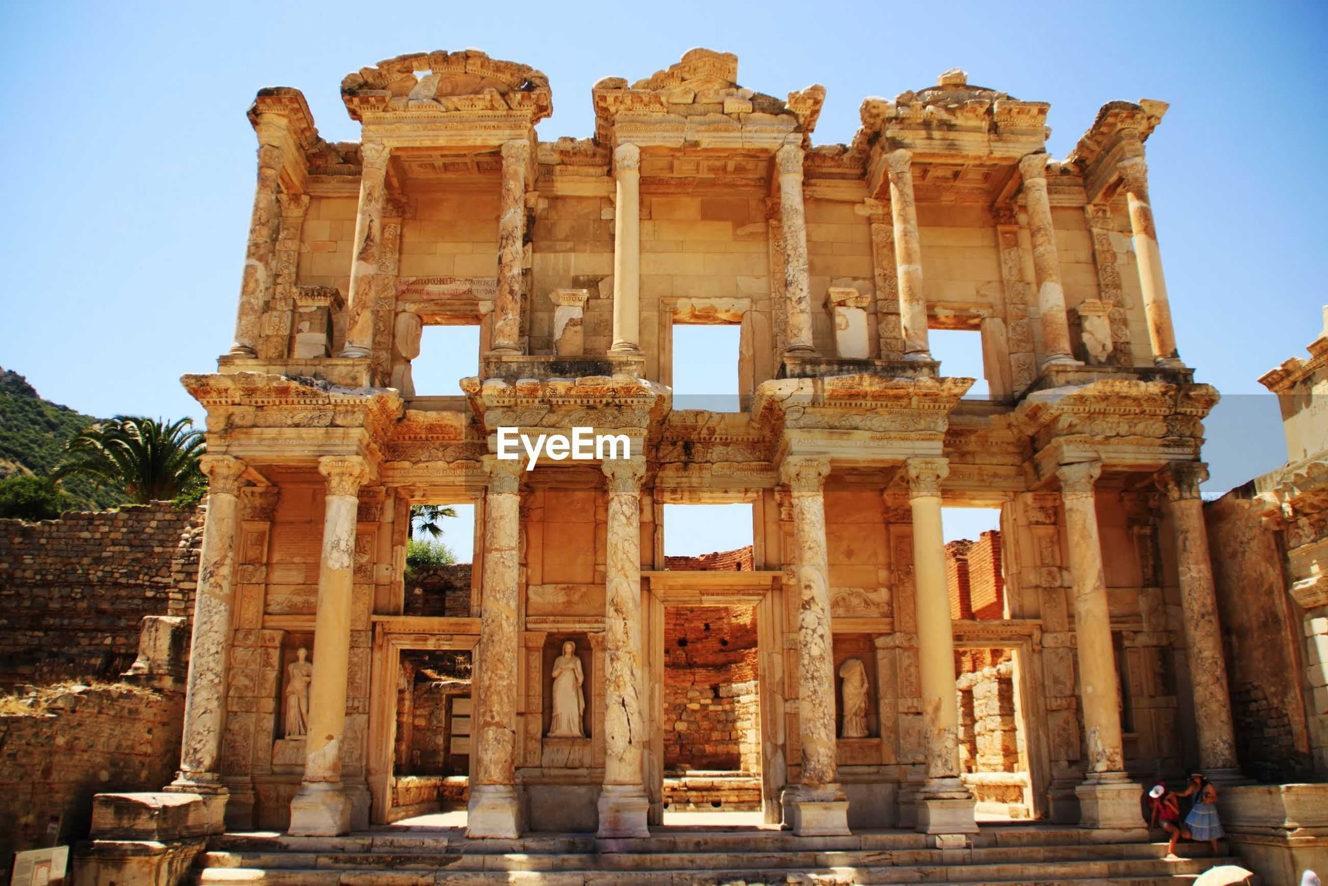 Low angle view of library of celsus against clear sky