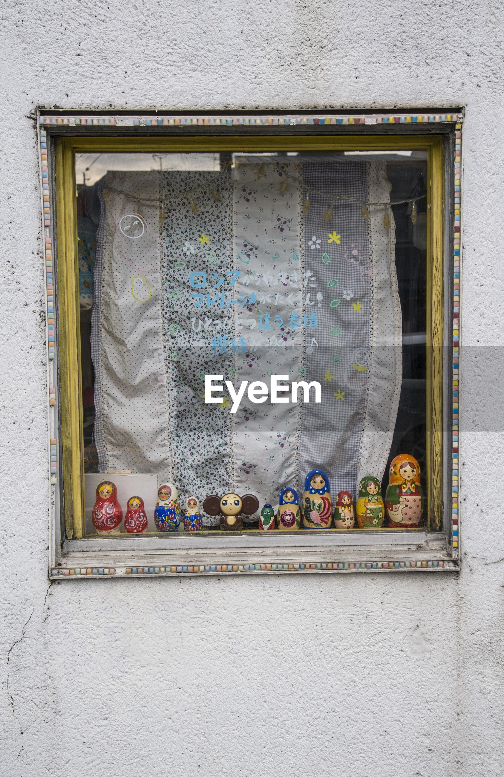 GRAFFITI ON GLASS WINDOW OF HOUSE