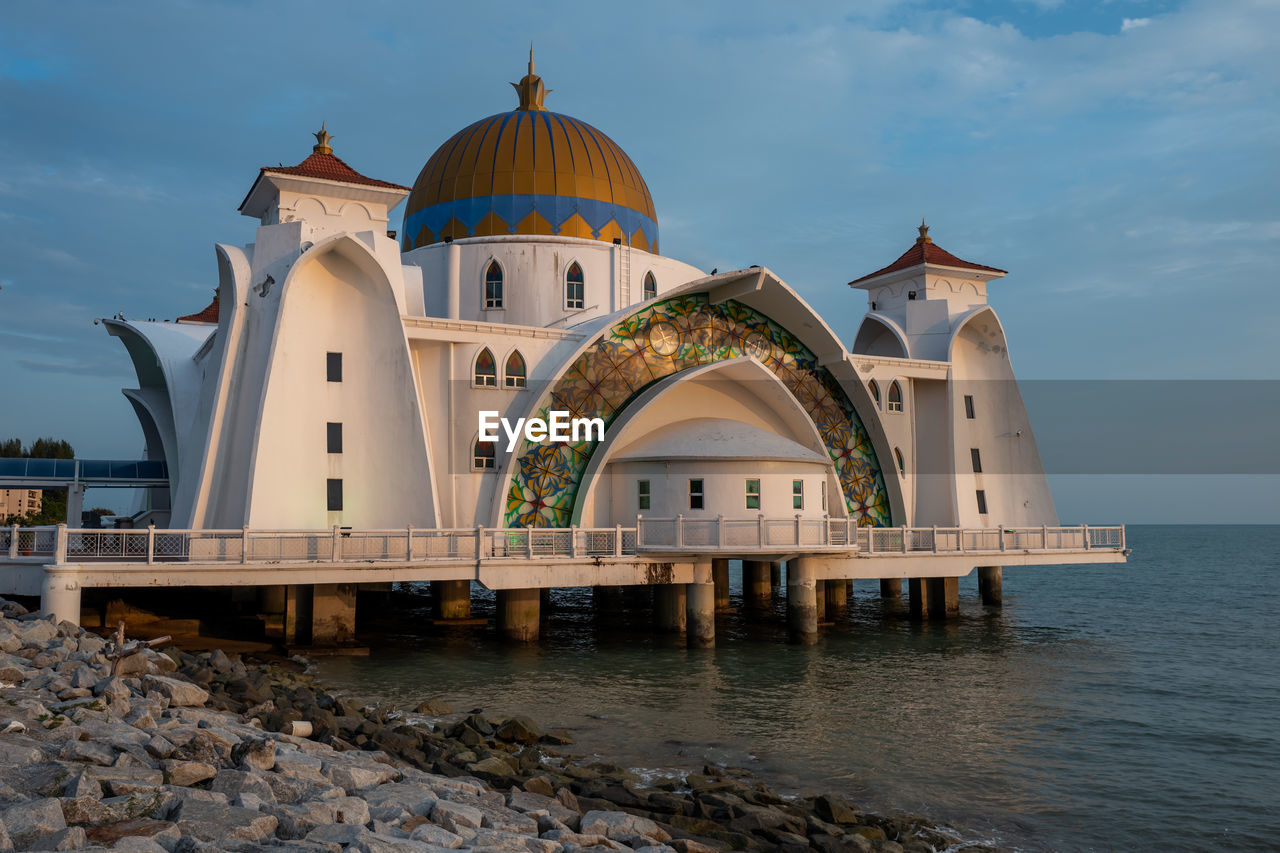 built structure, water, architecture, building exterior, sky, place of worship, building, religion, cloud - sky, belief, sea, spirituality, nature, dome, no people, waterfront, outdoors