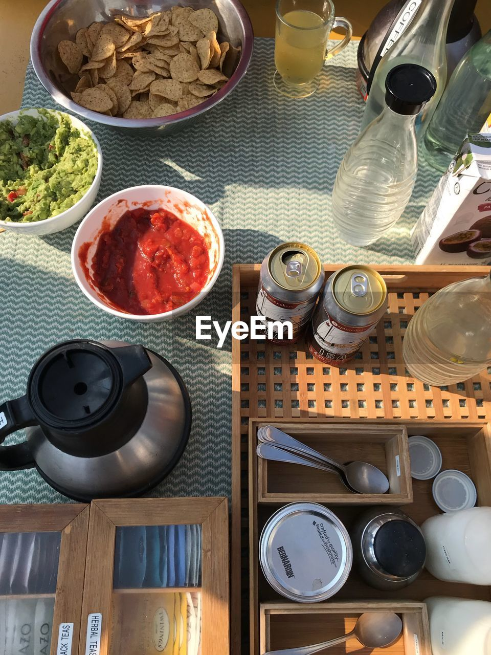 food and drink, table, food, still life, freshness, high angle view, no people, indoors, choice, variation, container, bowl, kitchen utensil, teapot, ready-to-eat, plate, large group of objects, cup, drink, refreshment, breakfast, crockery