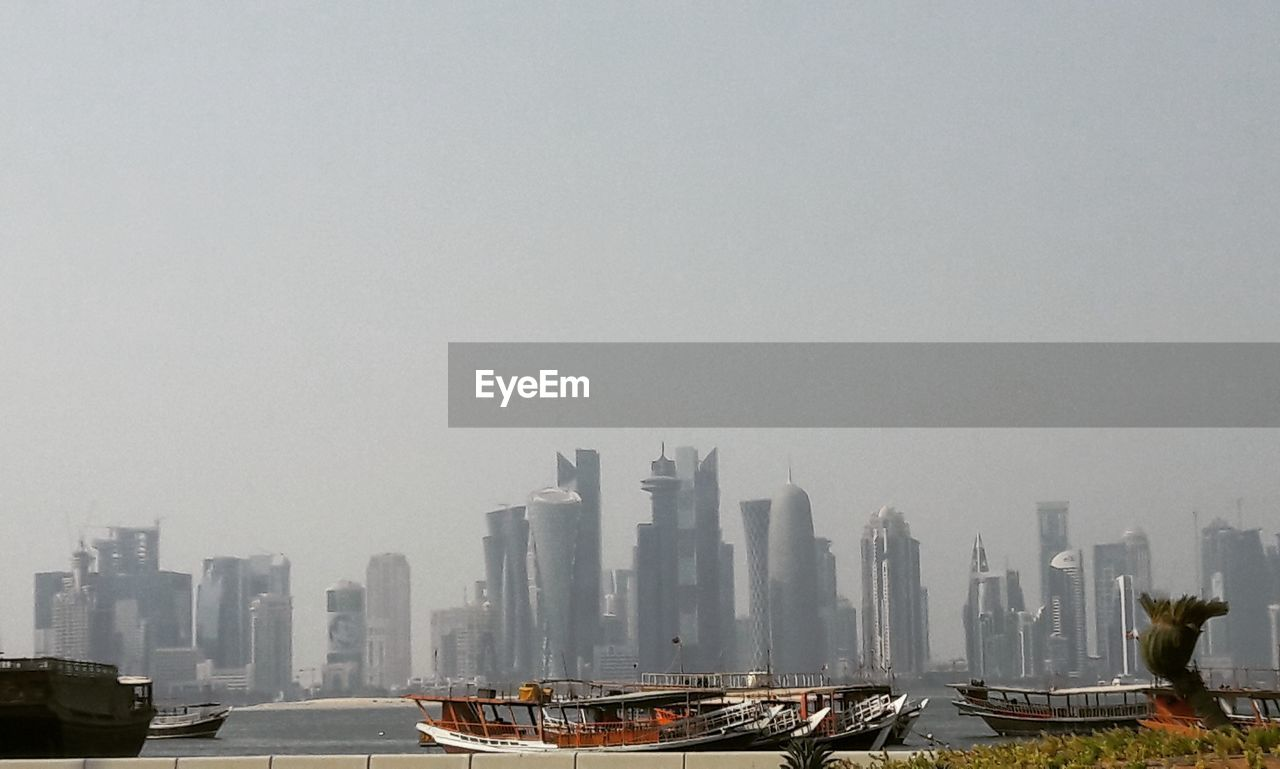 skyscraper, architecture, city, building exterior, built structure, modern, cityscape, transportation, clear sky, urban skyline, day, outdoors, water, no people, nautical vessel, sky, nature