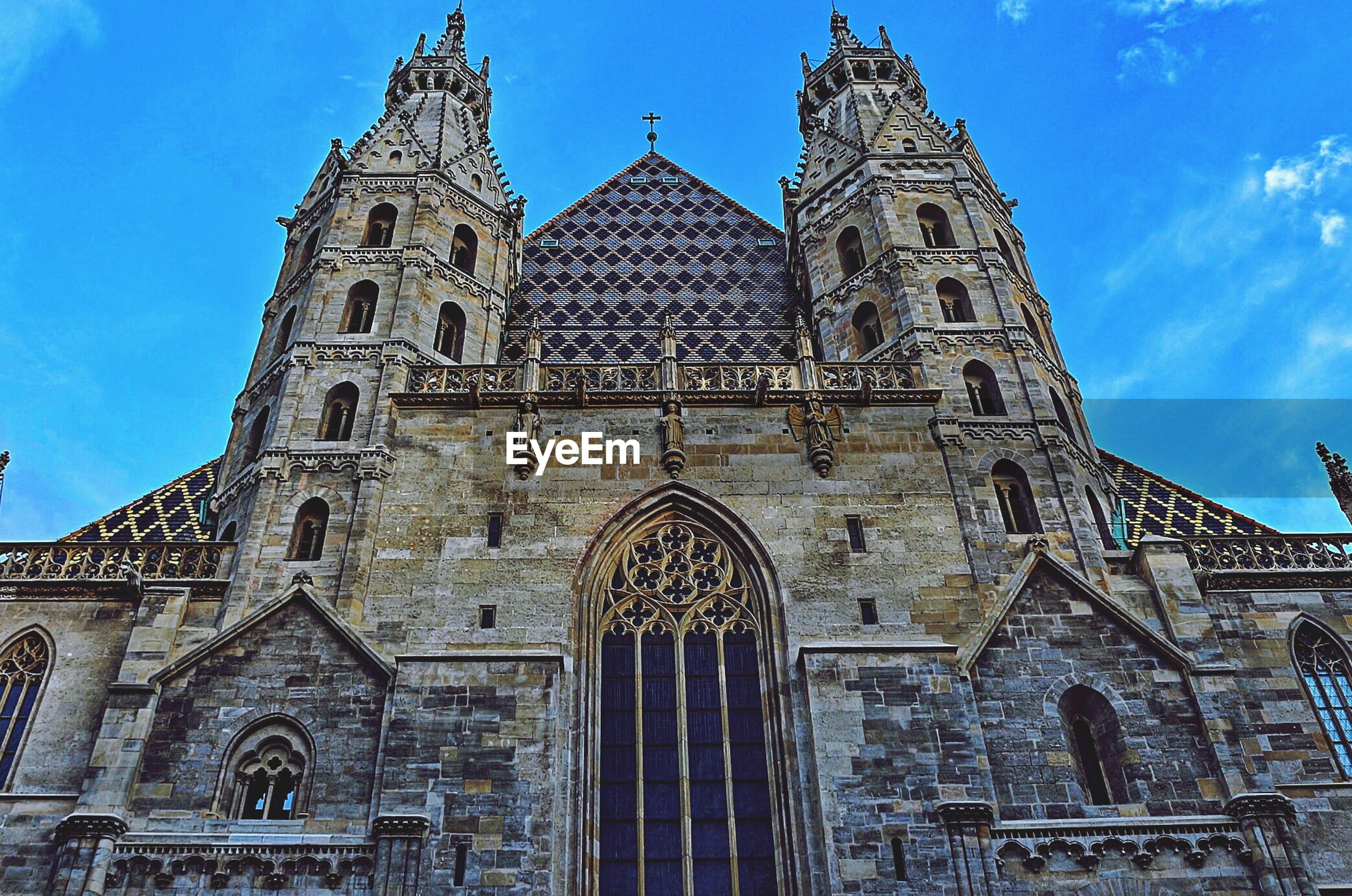 architecture, building exterior, built structure, religion, low angle view, place of worship, church, spirituality, cathedral, blue, famous place, travel destinations, history, sky, travel, tourism, facade, tower