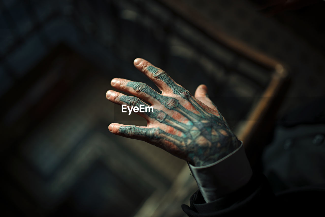 human hand, hand, human body part, focus on foreground, one person, indoors, body part, close-up, human finger, finger, lifestyles, tattoo, real people, selective focus, dirt, leisure activity, day, arts culture and entertainment, nail, human limb