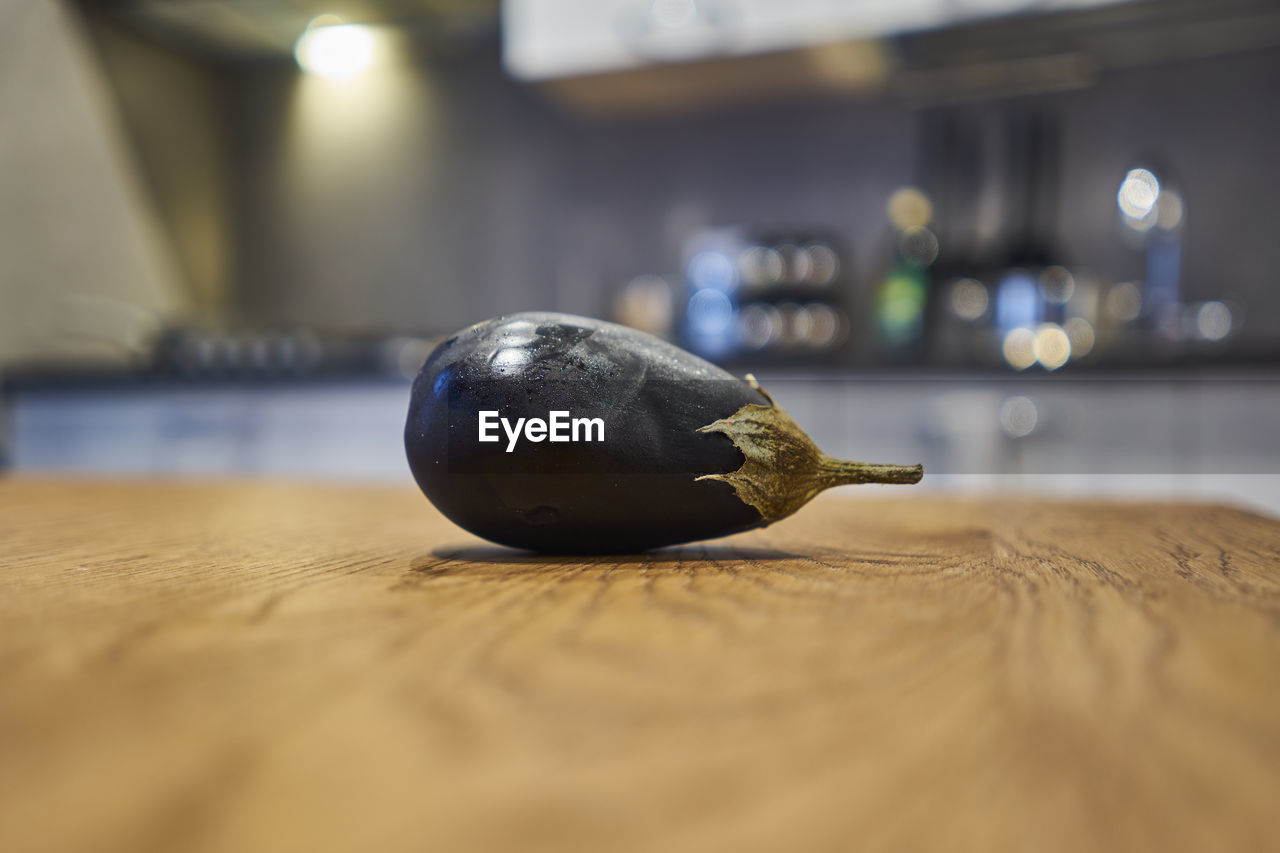 Close-up of eggplant on table at home