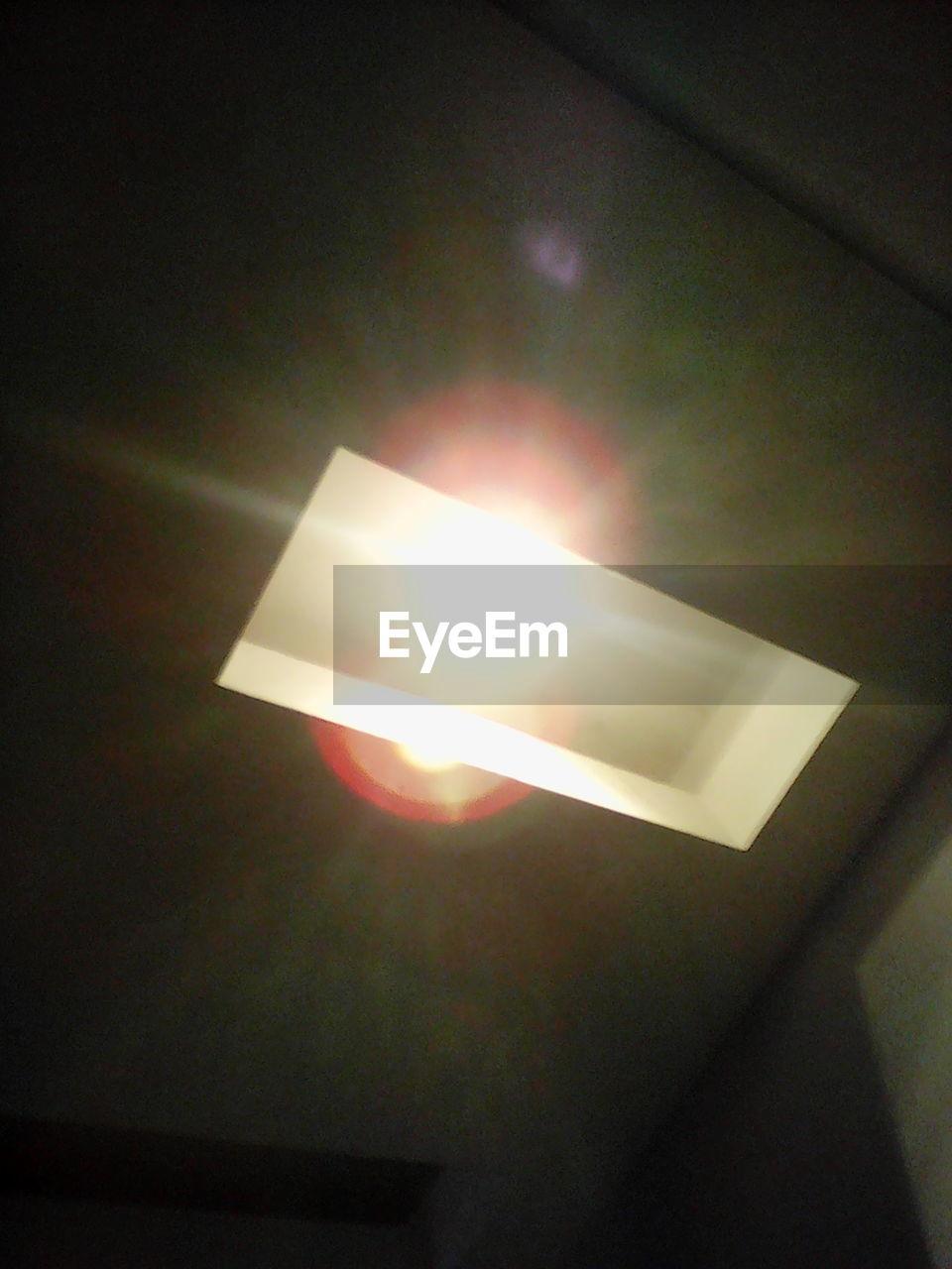 illuminated, glowing, lighting equipment, indoors, dark, close-up, no people, flame, night