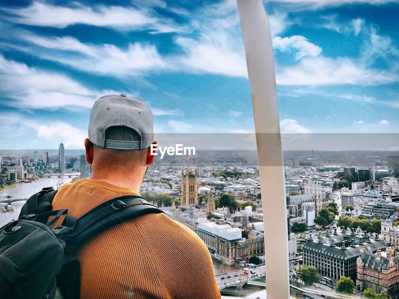 building exterior, architecture, built structure, city, cityscape, sky, rear view, cloud - sky, one person, men, real people, residential district, day, nature, crowd, building, lifestyles, portrait, crowded, outdoors, looking at view