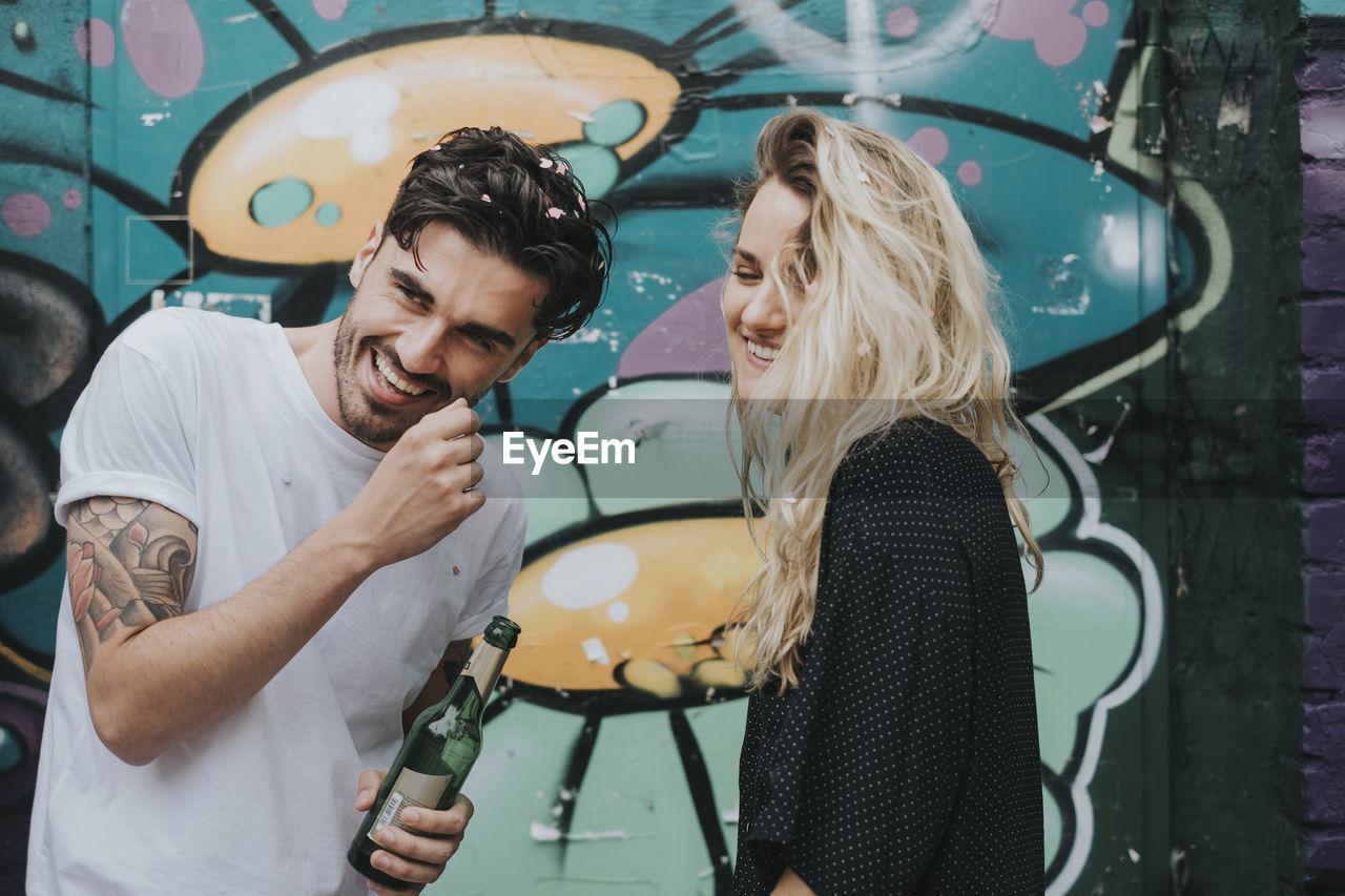 emotion, real people, young adult, two people, young women, casual clothing, women, lifestyles, happiness, togetherness, adult, positive emotion, love, young men, smiling, bonding, leisure activity, people, men, couple - relationship, hair, hairstyle