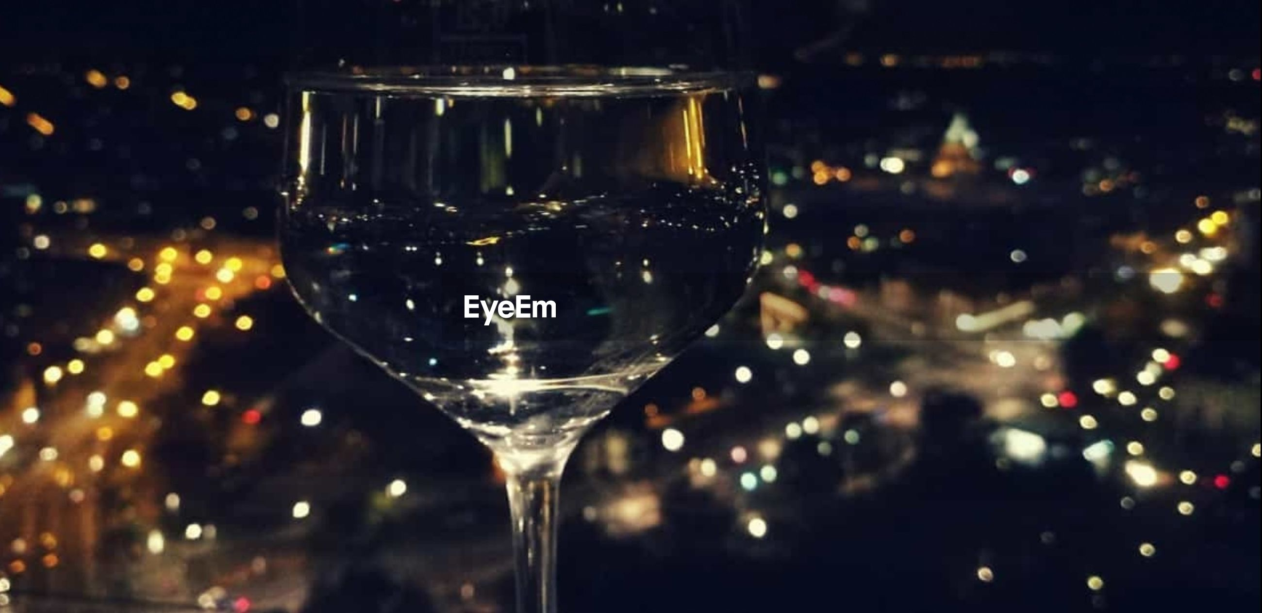 refreshment, drink, food and drink, glass, alcohol, focus on foreground, close-up, wine, no people, glass - material, transparent, wineglass, household equipment, drinking glass, night, illuminated, freshness, indoors, food, nightlife