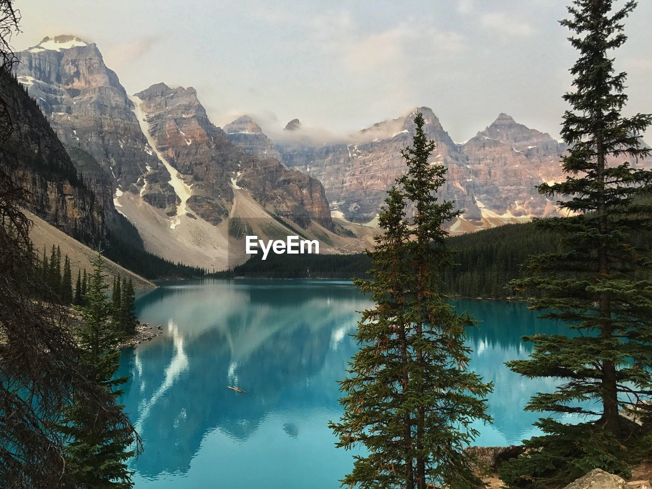 mountain, reflection, scenics, mountain range, lake, nature, beauty in nature, water, tranquil scene, tranquility, sky, idyllic, tree, day, outdoors, no people, snow