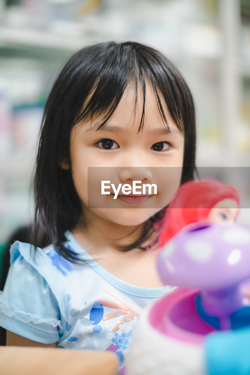 portrait, childhood, headshot, smiling, one person, innocence, child, looking at camera, females, real people, front view, girls, selective focus, indoors, happiness, women, focus on foreground, bangs, hairstyle