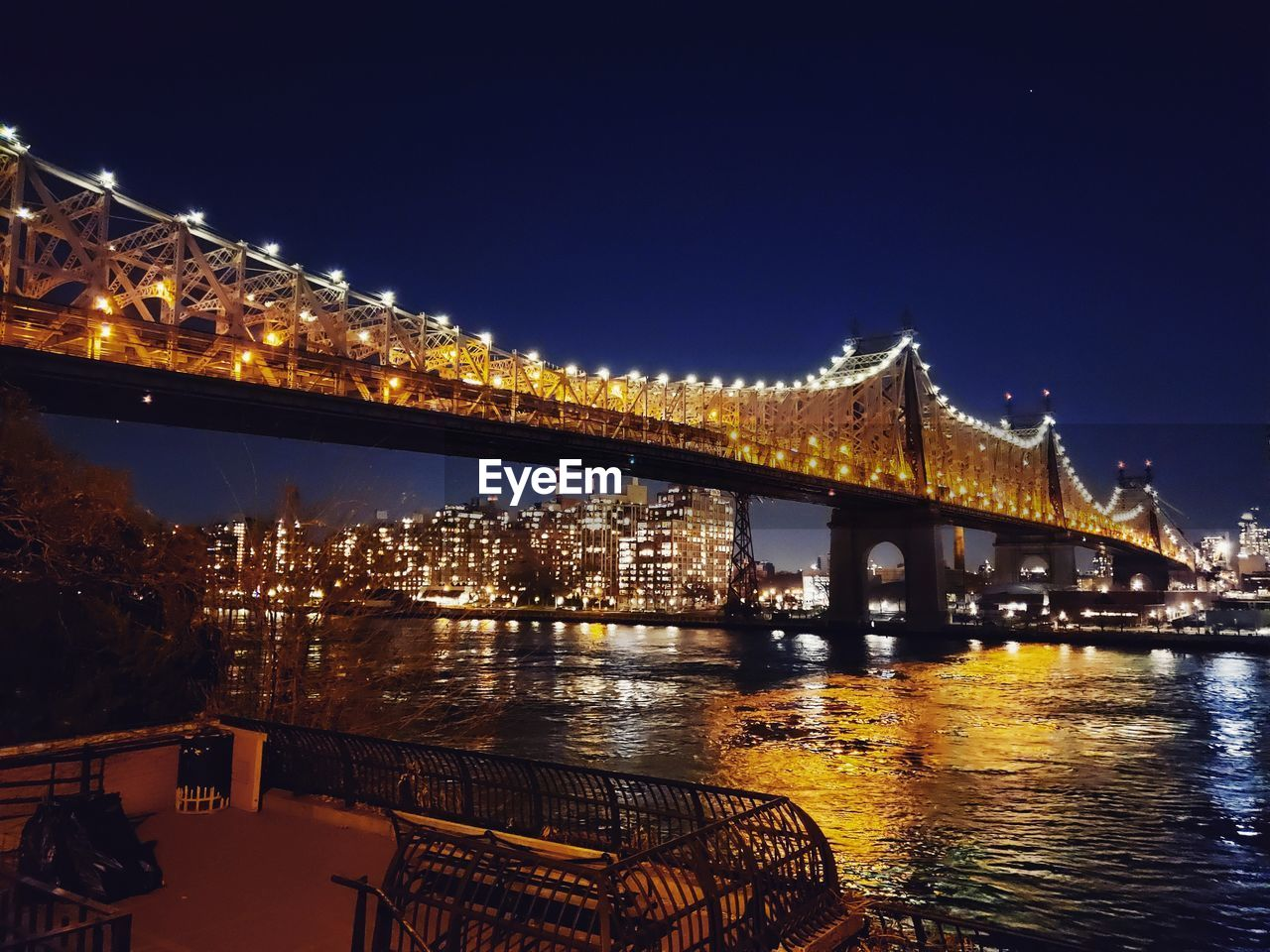 illuminated, water, built structure, architecture, night, connection, bridge, bridge - man made structure, river, sky, building exterior, transportation, reflection, city, no people, nature, chain bridge, waterfront, outdoors