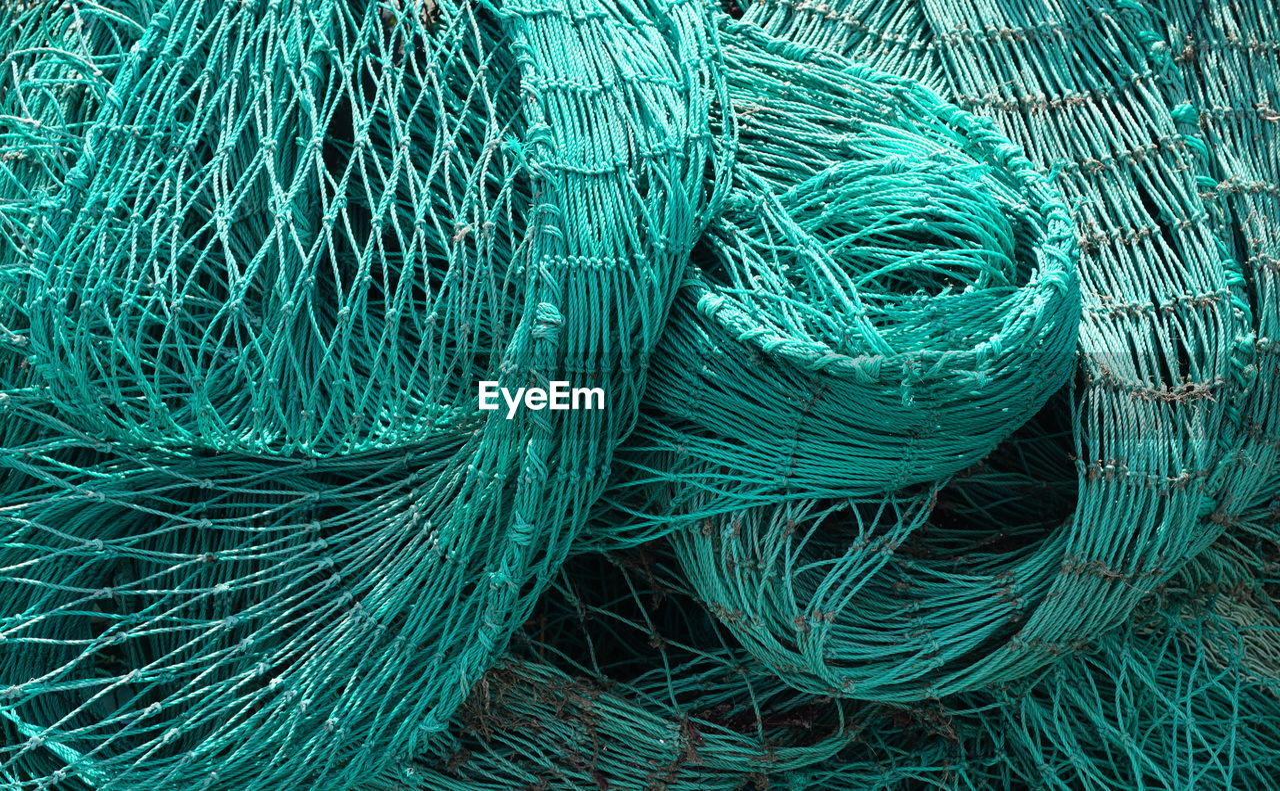 Full Frame Shot Of Fishing Net At Harbor