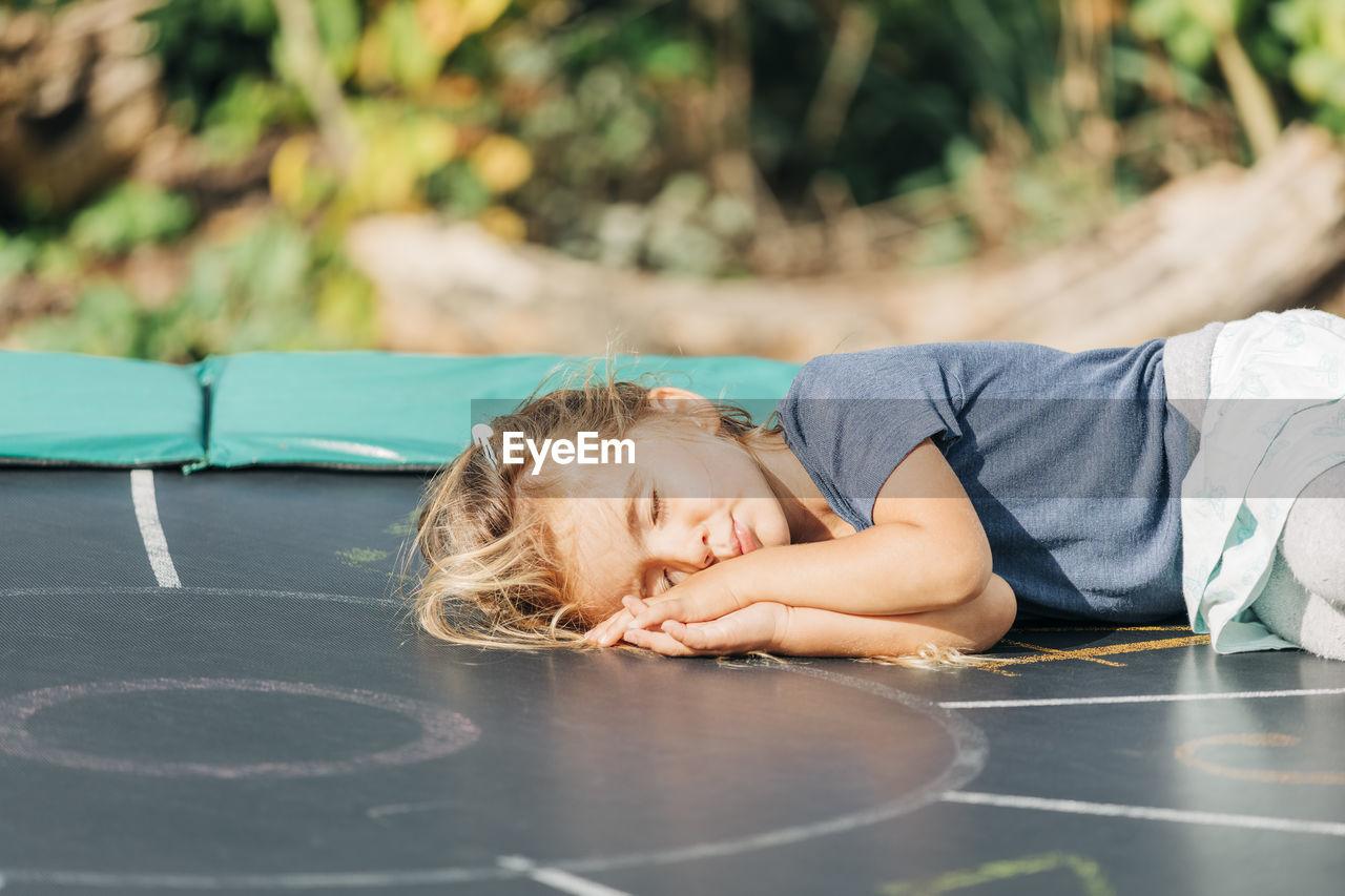 Cute girl lying down outdoors