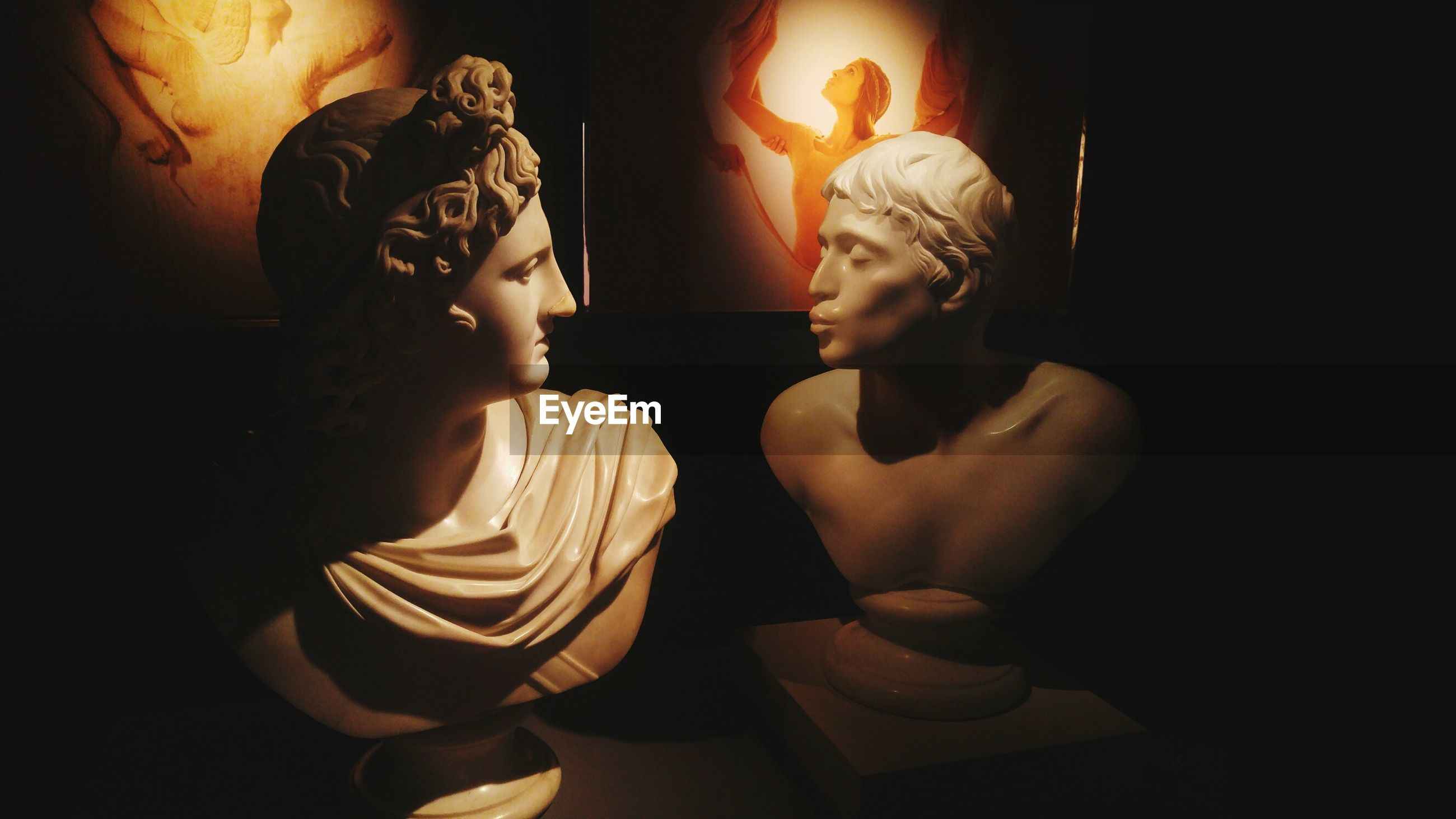 human representation, female likeness, illuminated, indoors, statue, no people, sculpture, studio shot, black background, close-up, day