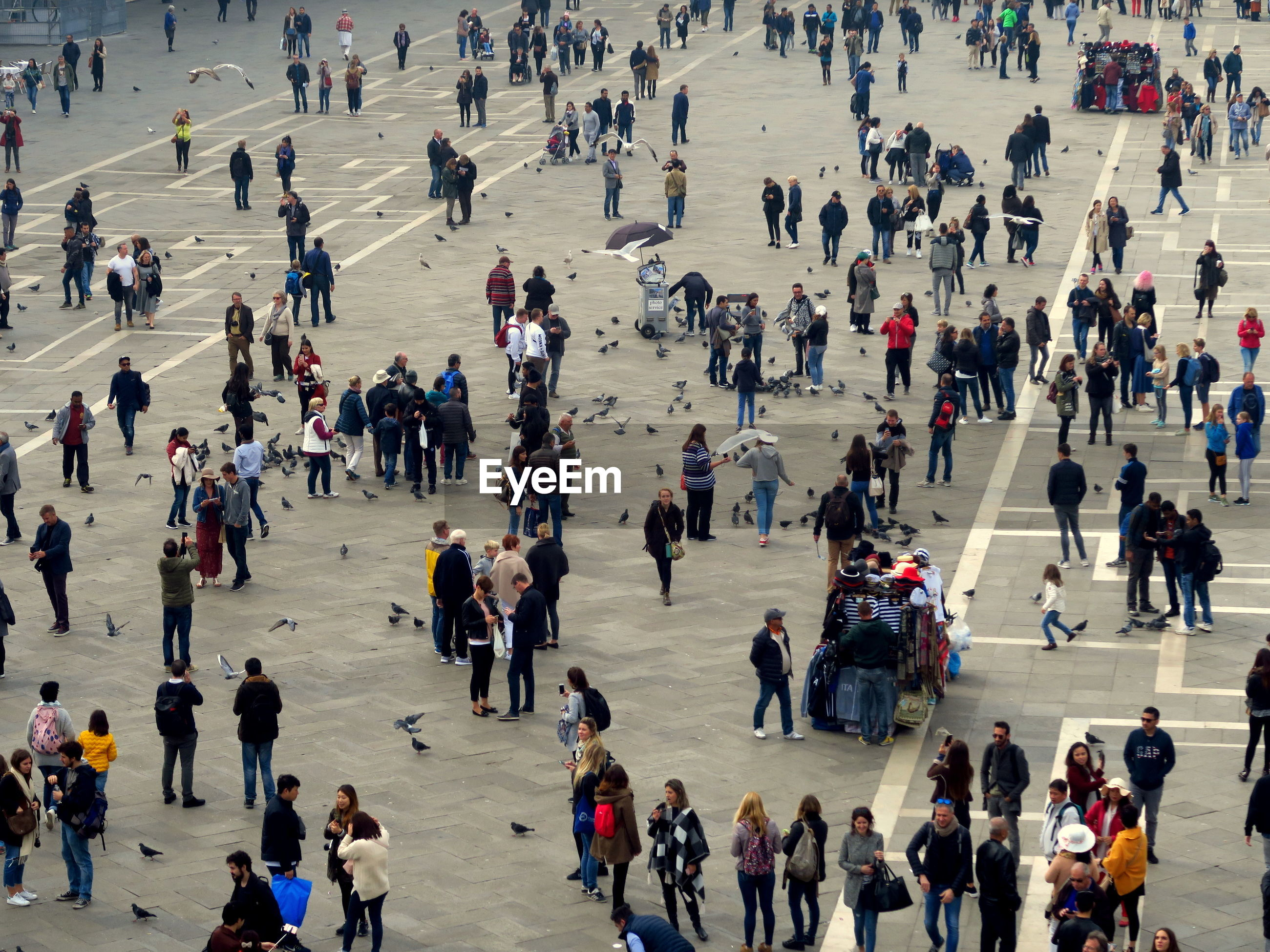 High angle view of people walking on city square