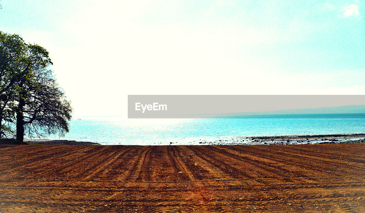 scenics, nature, beauty in nature, tranquil scene, sea, sky, tranquility, day, outdoors, no people, sand, horizon over water, landscape, beach, water