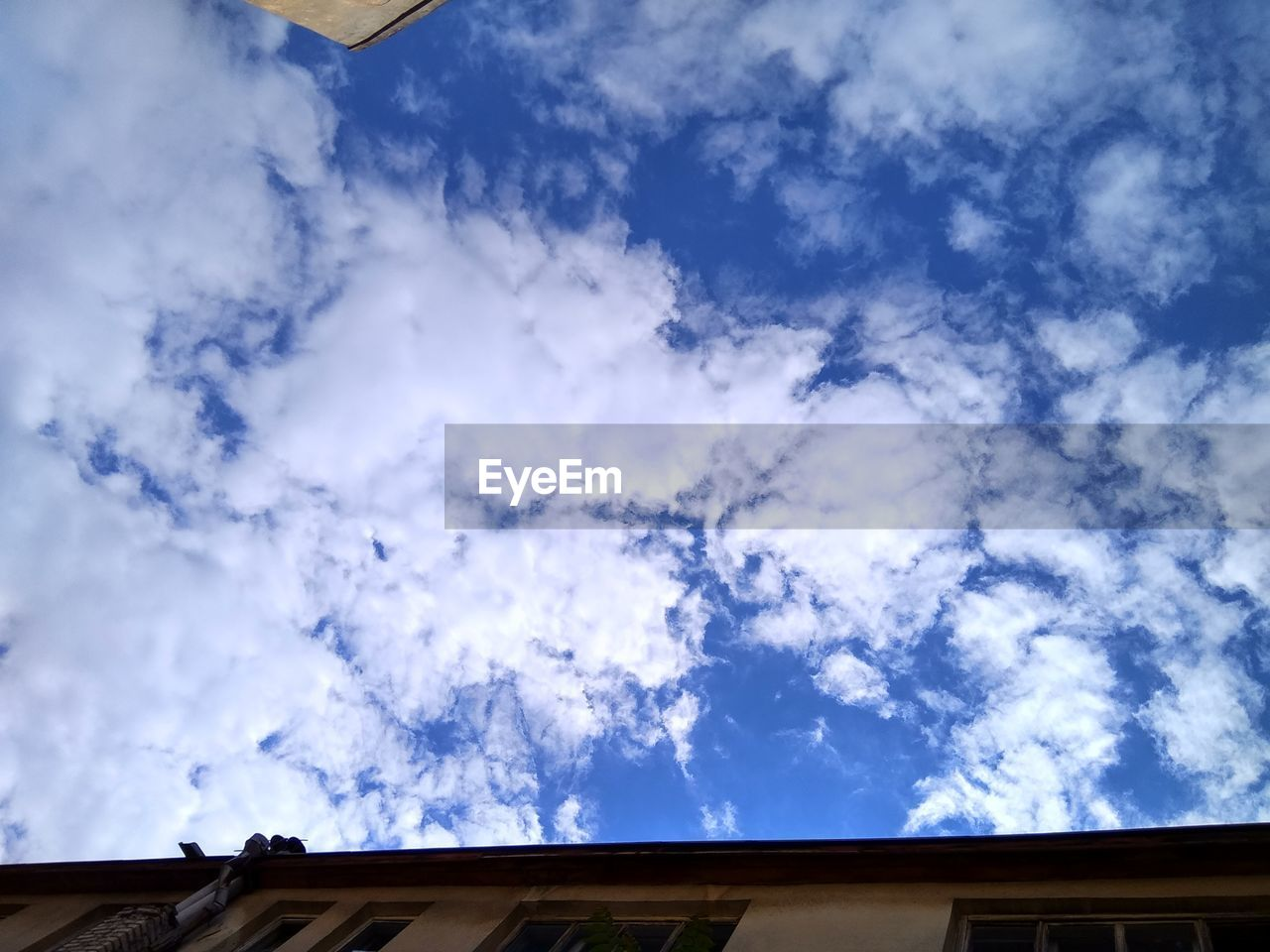 cloud - sky, low angle view, sky, roof, day, no people, nature, outdoors, blue, beauty in nature, architecture, building exterior