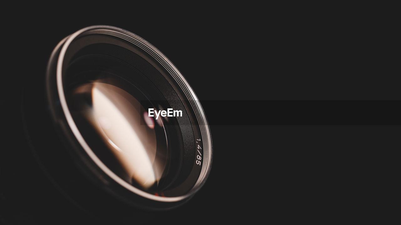 Close-Up Of Lens In Darkroom