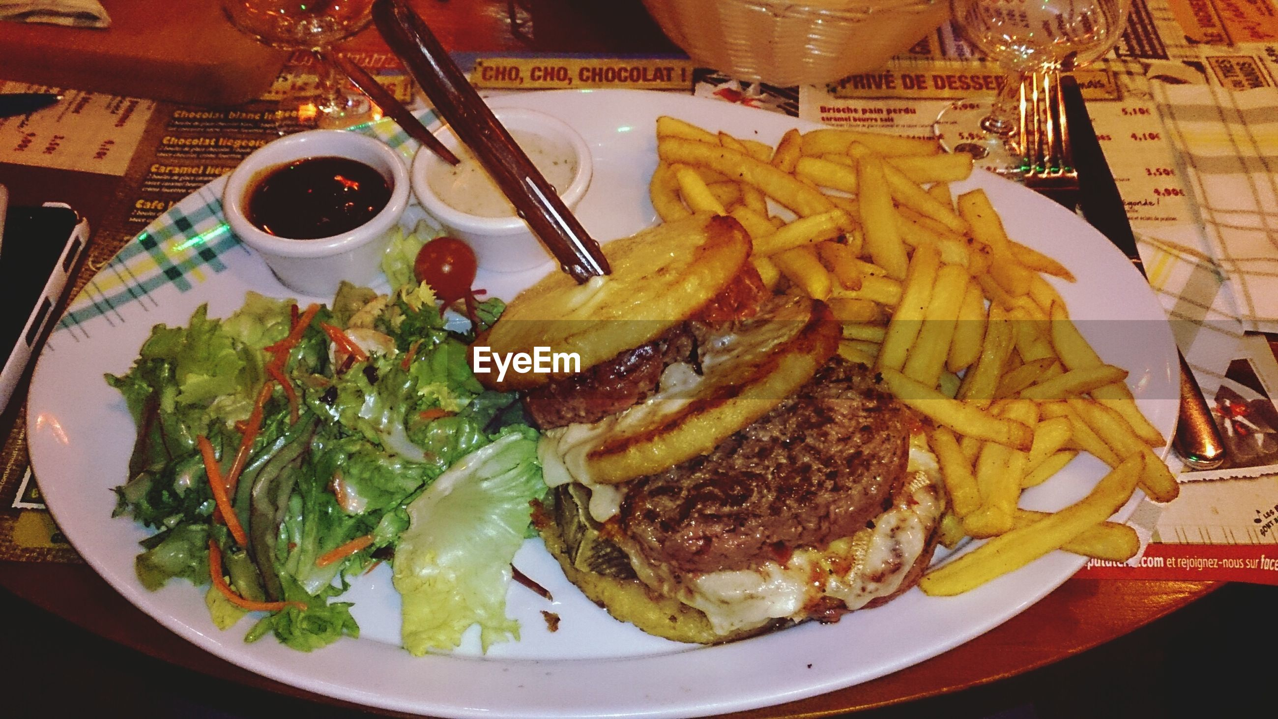 food and drink, food, ready-to-eat, plate, freshness, indoors, table, serving size, still life, high angle view, meal, indulgence, served, close-up, healthy eating, fork, meat, french fries, restaurant
