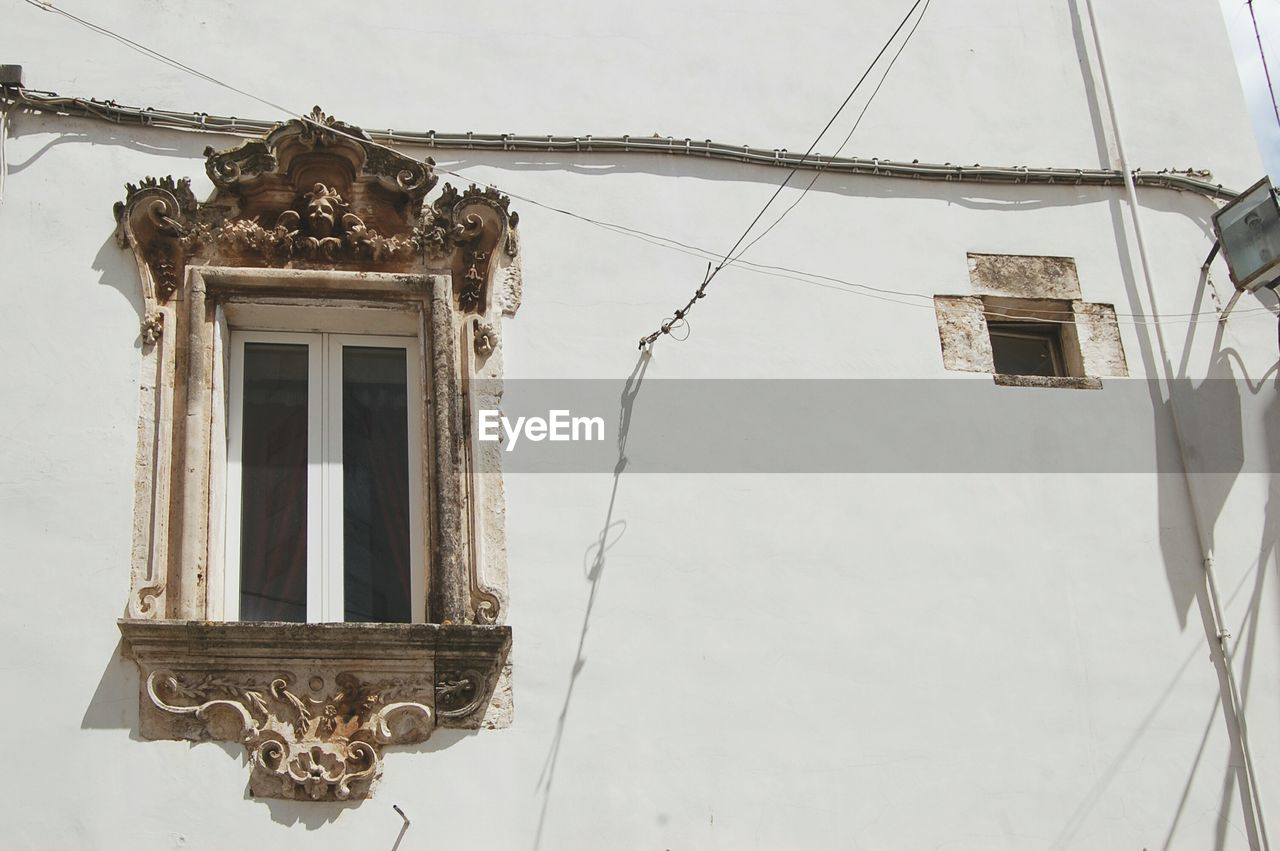 Baroque window on a white wall
