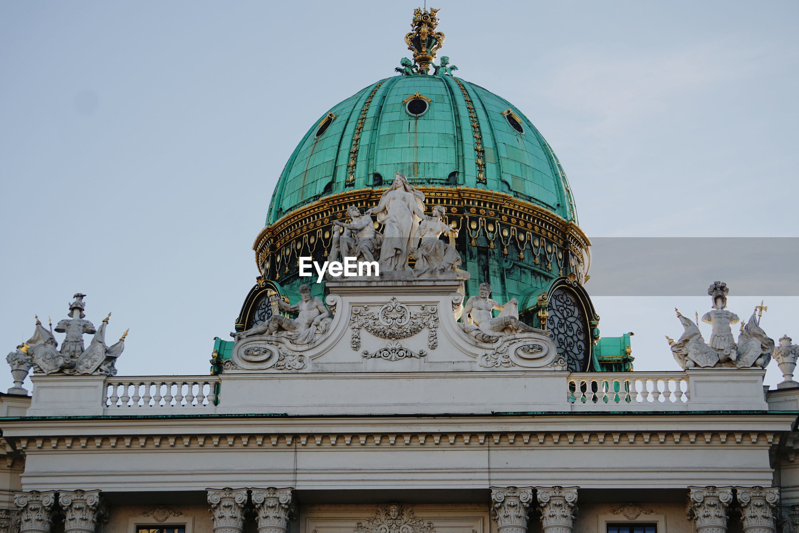 Low angle view of hofburg against sky in city